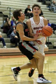 Brighton's Keenan Stolz takes the ball into the paint against Pinckney's Dylan Reason on Thursday, Jan. 3, 2019.