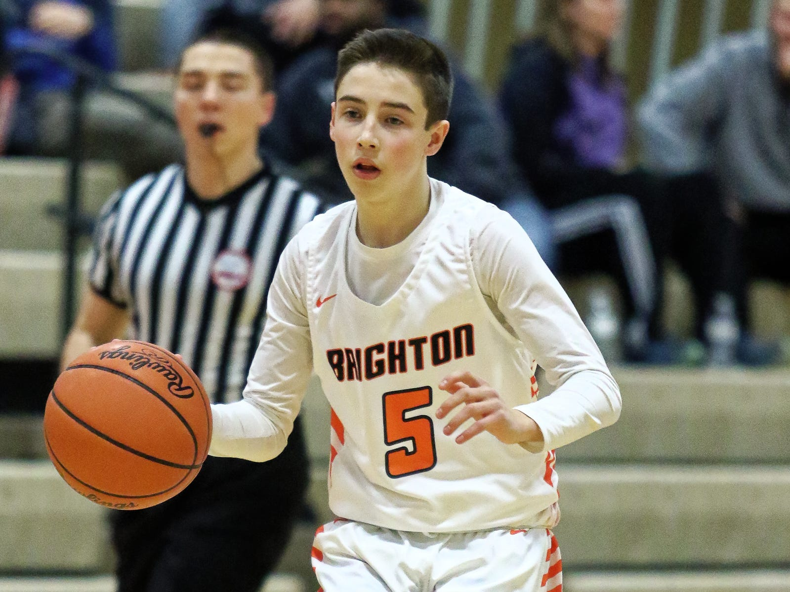 Brighton's Zachary Whalen brings the ball up court in a 60-33 victory over Pinckney on Thursday, Jan. 3, 2019.