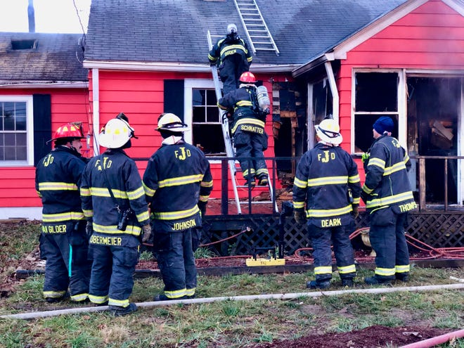 Jeffersonville Fire Department personnel respond to a house fire that left one man and a dog dead in the 500 block of Allison Lane on Friday, Jan. 4, 2019.