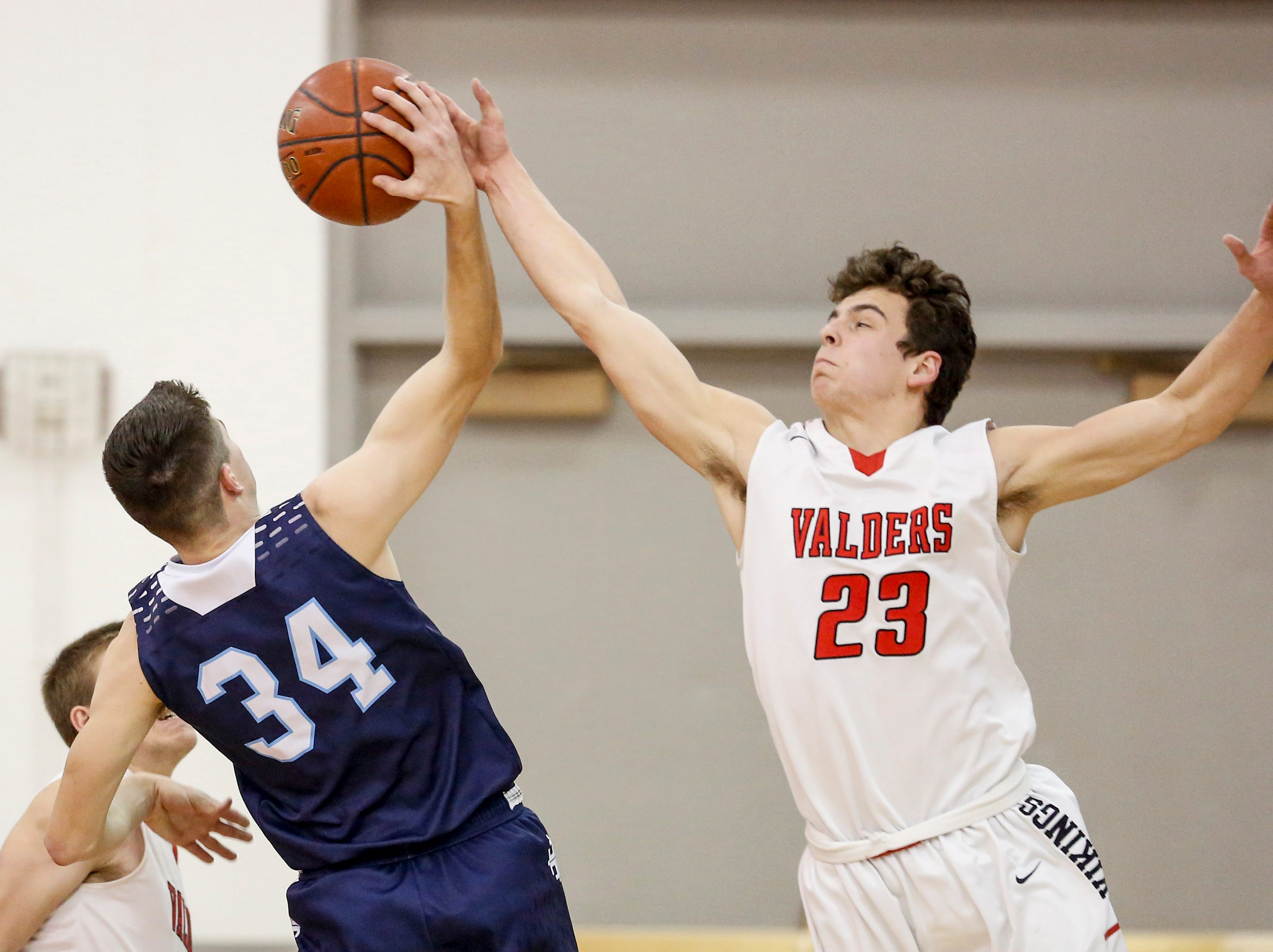 Roncalli's Ian Behringer battles Valders' Reese Brown for a rebound during an Eastern Wisconsin Conference game at Valders High School Thursday, January 3, 2019, in Valders, Wis. Joshua Clark/USA TODAY NETWORK-Wisconsin