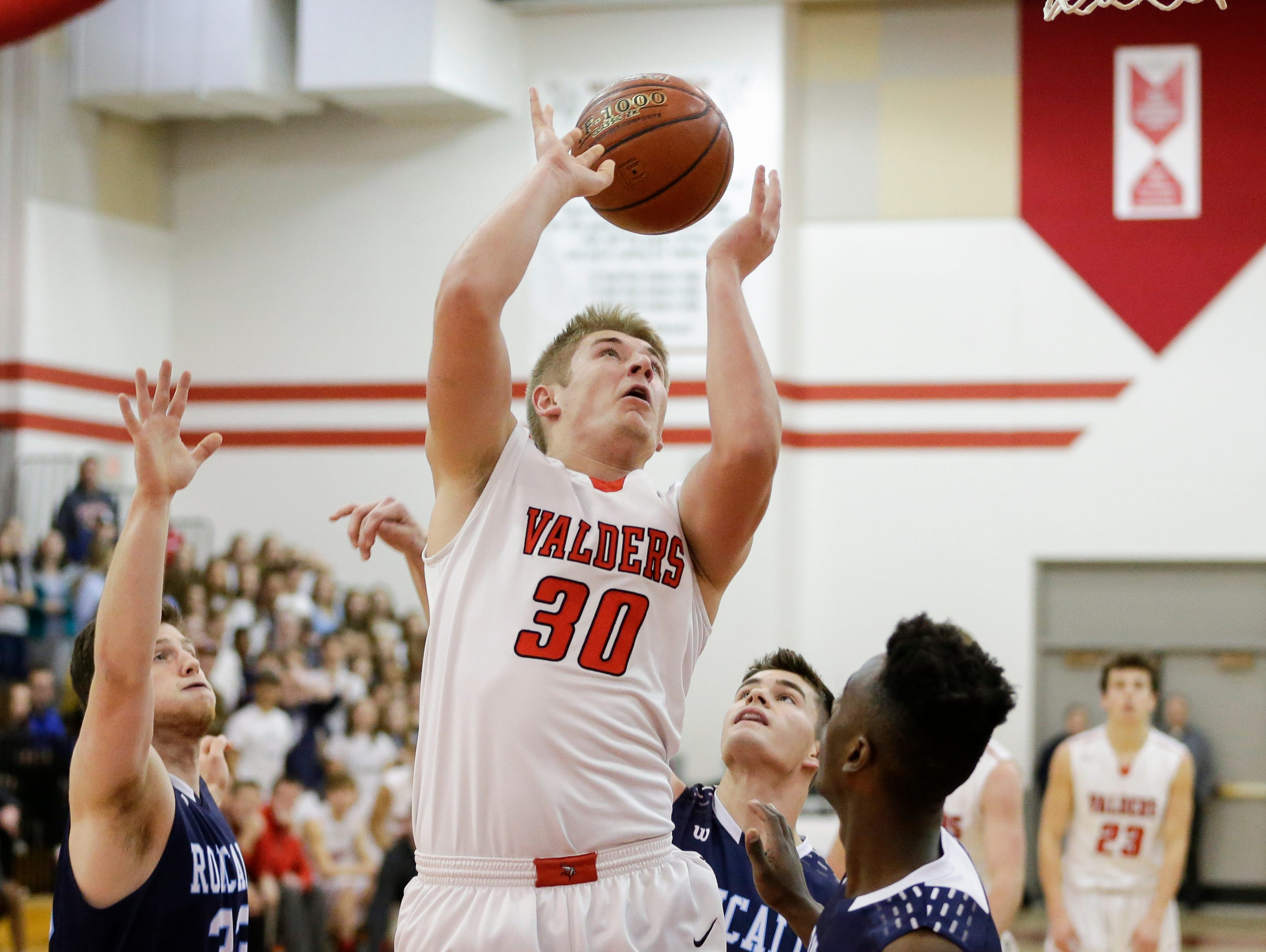 Valders' Zack Weyker puts up a shot against Roncalli during an Eastern Wisconsin Conference game at Valders High School Thursday, January 3, 2019, in Valders, Wis. Joshua Clark/USA TODAY NETWORK-Wisconsin