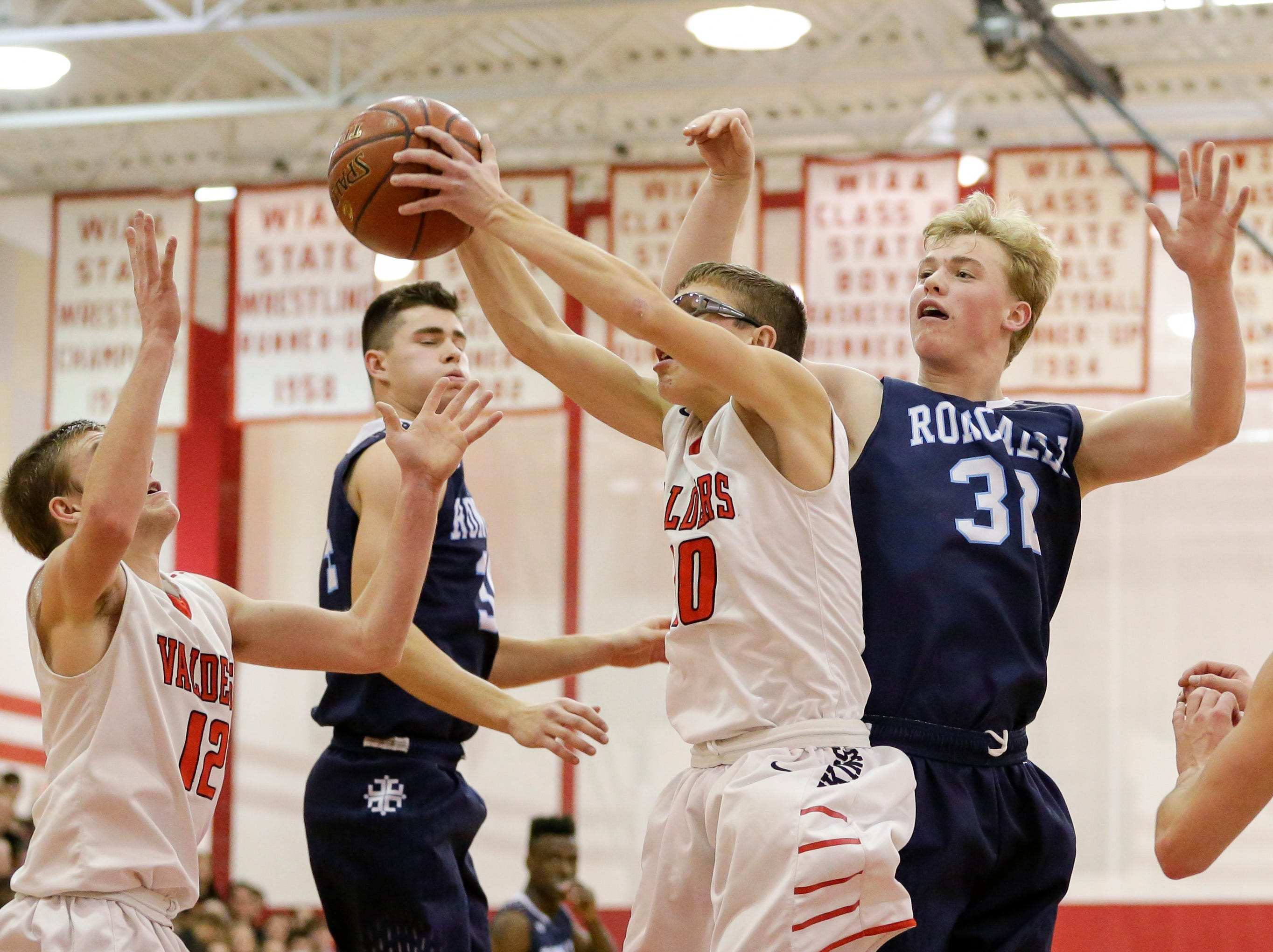 Valders' Aiden Fochs (10) grabs a rebound against Roncalli during an Eastern Wisconsin Conference game at Valders High School Thursday, January 3, 2019, in Valders, Wis. Joshua Clark/USA TODAY NETWORK-Wisconsin