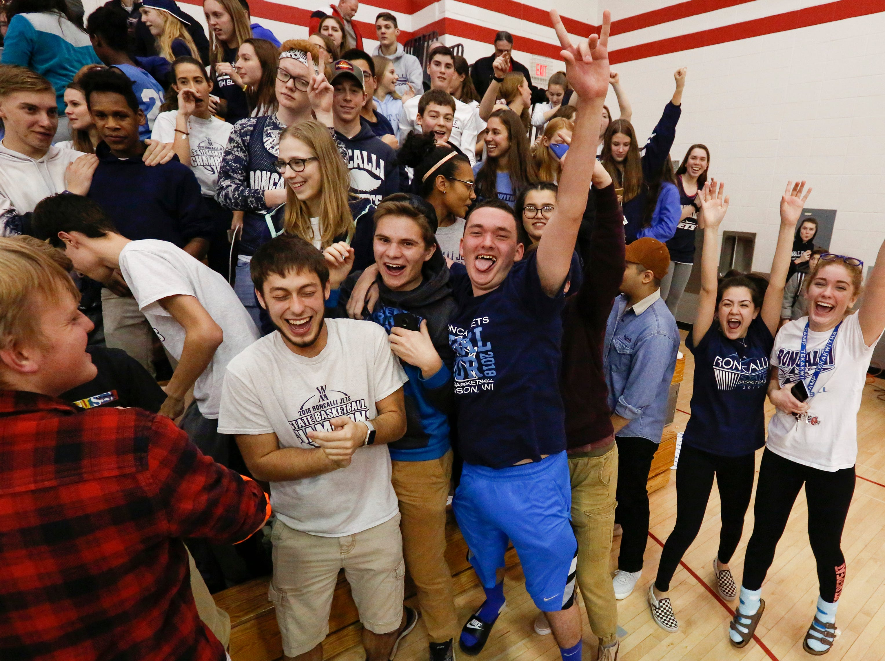 Roncalli's student section celebrates an overtime win over Valders during an Eastern Wisconsin Conference game at Valders High School Thursday, January 3, 2019, in Valders, Wis. Joshua Clark/USA TODAY NETWORK-Wisconsin