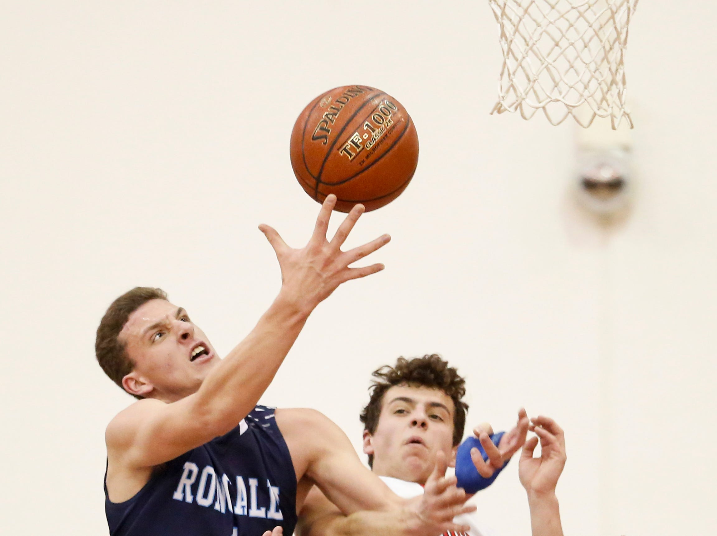 Roncalli's Daniel Burgarino (1) fends off Valders' Reese Brown for a rebound during an Eastern Wisconsin Conference game at Valders High School Thursday, January 3, 2019, in Valders, Wis. Joshua Clark/USA TODAY NETWORK-Wisconsin