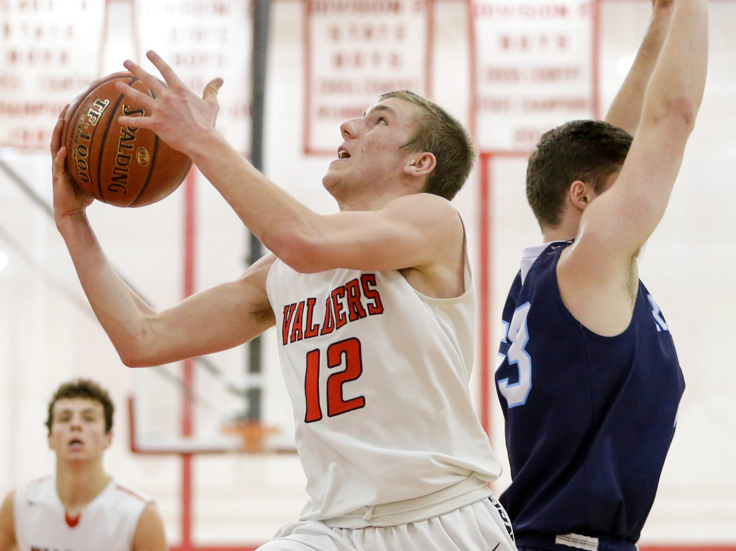 Valders' Trevor Leist shoots against Roncalli during an Eastern Wisconsin Conference game at Valders High School Thursday, January 3, 2019, in Valders, Wis. Joshua Clark/USA TODAY NETWORK-Wisconsin