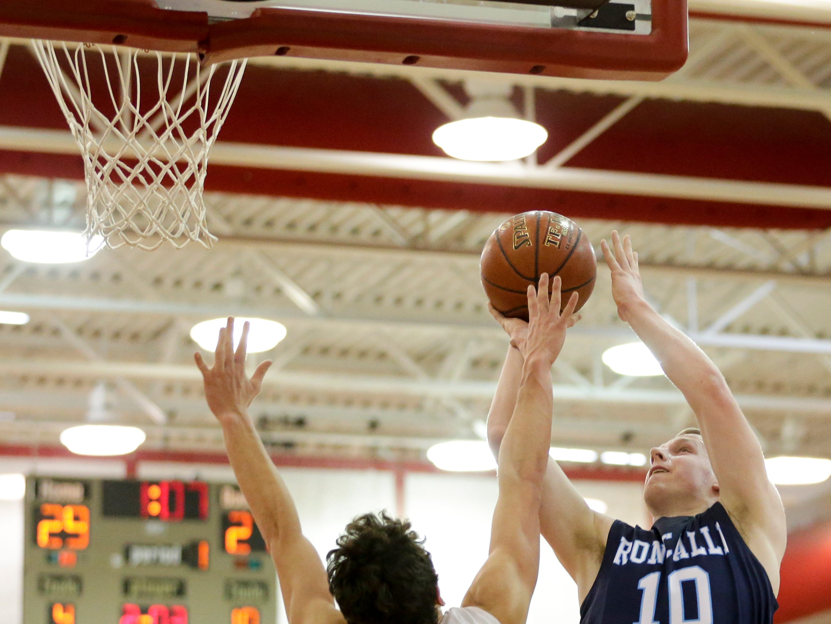 Roncalli's Matthew La Vene puts up a shot over Valders' Reese Brown during an Eastern Wisconsin Conference game at Valders High School Thursday, January 3, 2019, in Valders, Wis. Joshua Clark/USA TODAY NETWORK-Wisconsin
