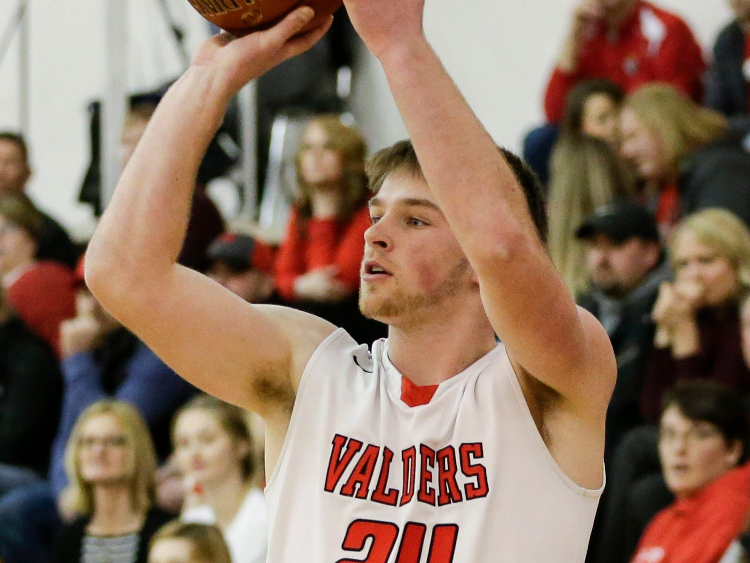 Valders' Dallas Fletcher (24) puts up a shot against Roncalli during an Eastern Wisconsin Conference game at Valders High School Thursday, January 3, 2019, in Valders, Wis. Joshua Clark/USA TODAY NETWORK-Wisconsin
