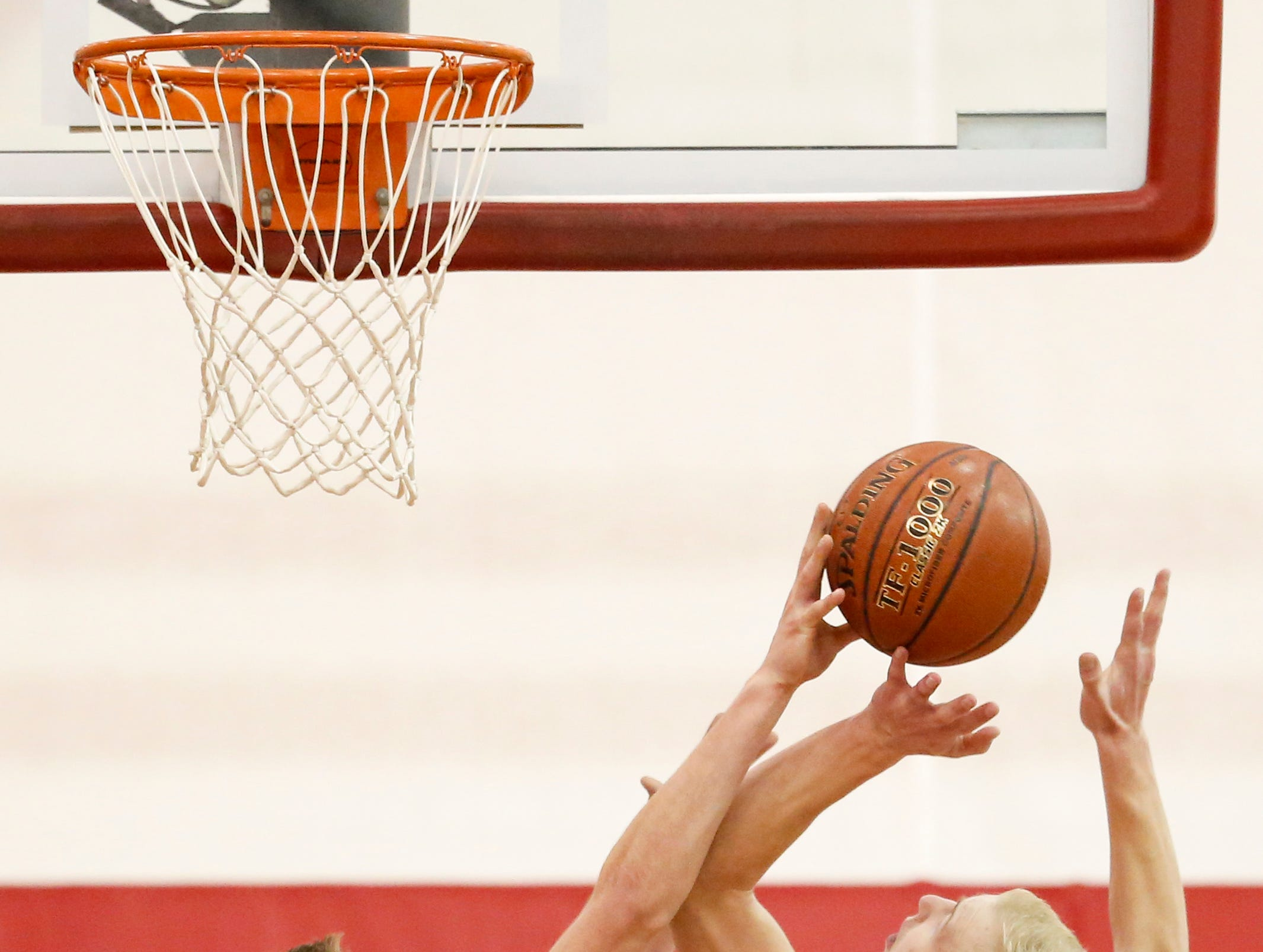 Valders' Trevor Leist (12) blocks a shot from Roncalli's Bryce Pautz (4) during an Eastern Wisconsin Conference game at Valders High School Thursday, January 3, 2019, in Valders, Wis. Joshua Clark/USA TODAY NETWORK-Wisconsin