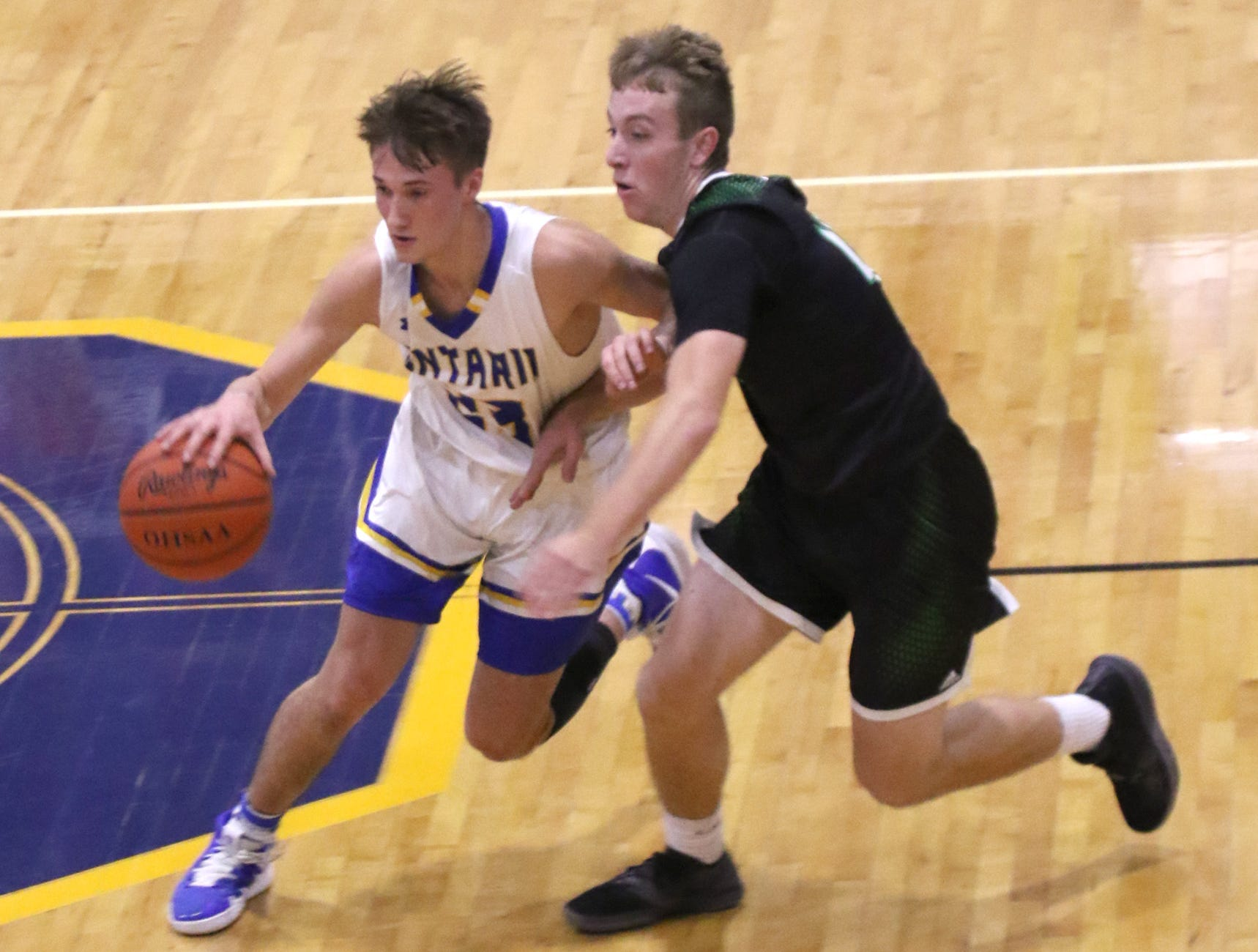 Ontraio's Jon Nagel moves the ball down the court while playing a home game against Clear Fork on Thursday.