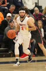 Galion's Isaiah Alsip dribbles the ball down the court while playing a home game against Shelby earlier in the season.