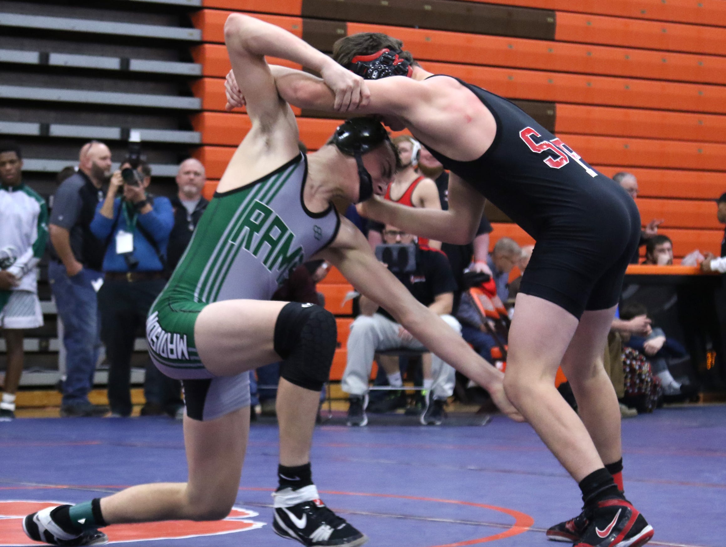 Madison's Nate Barrett spars with his opponent during the J.C. Gorman Wrestling Tournament on Friday.