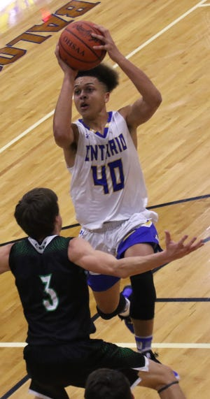 Ontario's Jayden Jacobs attempts a jump shot while playing a home game against Clear Fork earlier in the season.