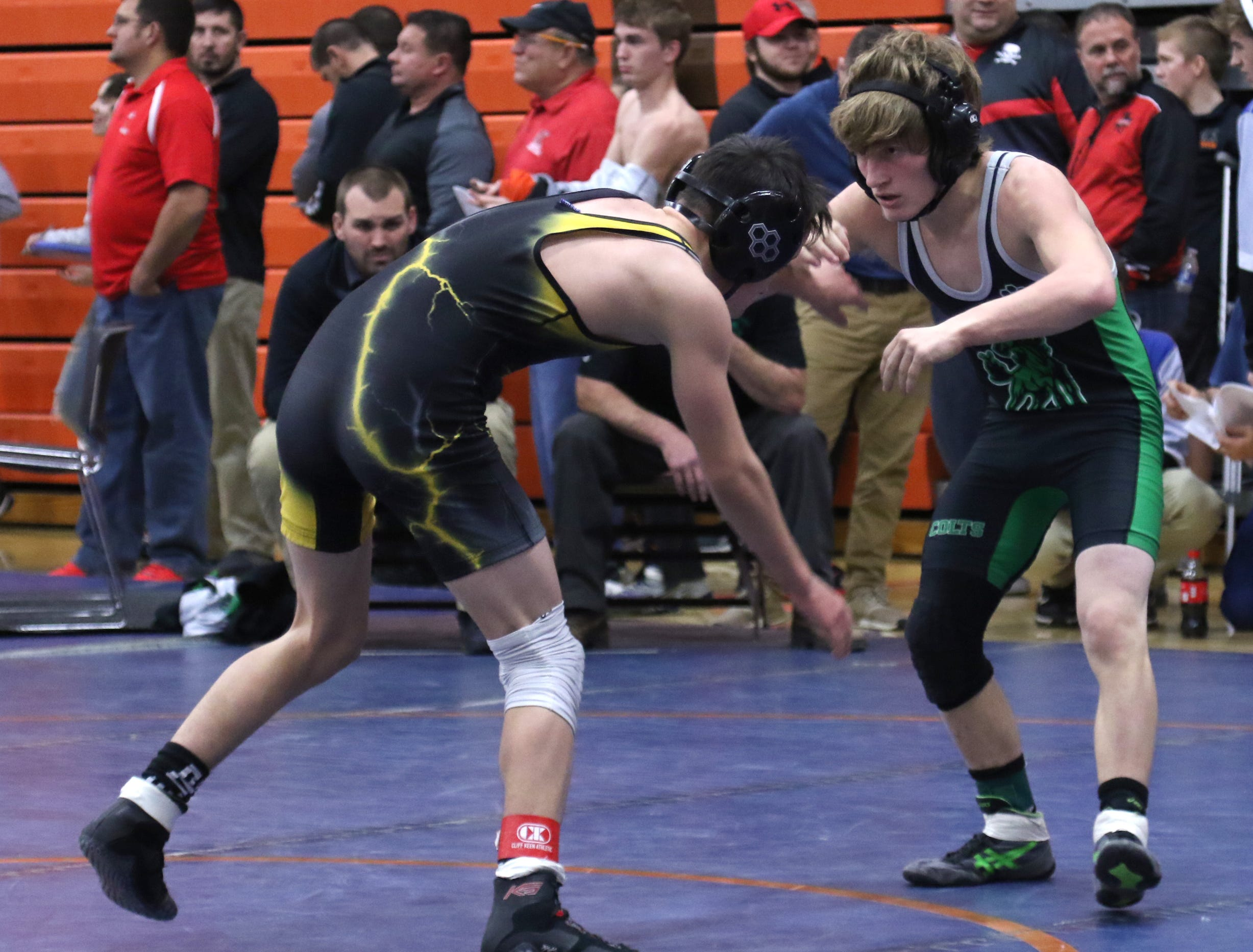 Clear Fork's Travis Bowman spars with his opponent during the J.C. Gorman Wrestling Tournament on Friday.