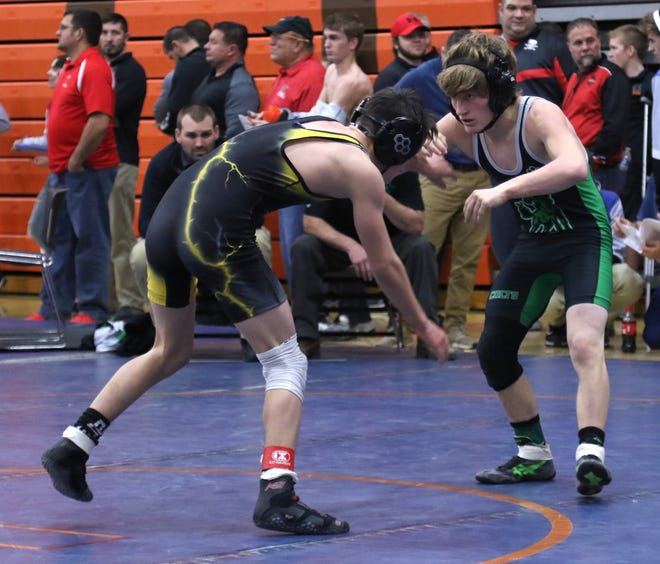Travis Bowman (right) competes for a Clear Fork squad that was part of a 37-team field for this weekend's 57th J.C. Gorman Invitational at Mansfield Senior High School.