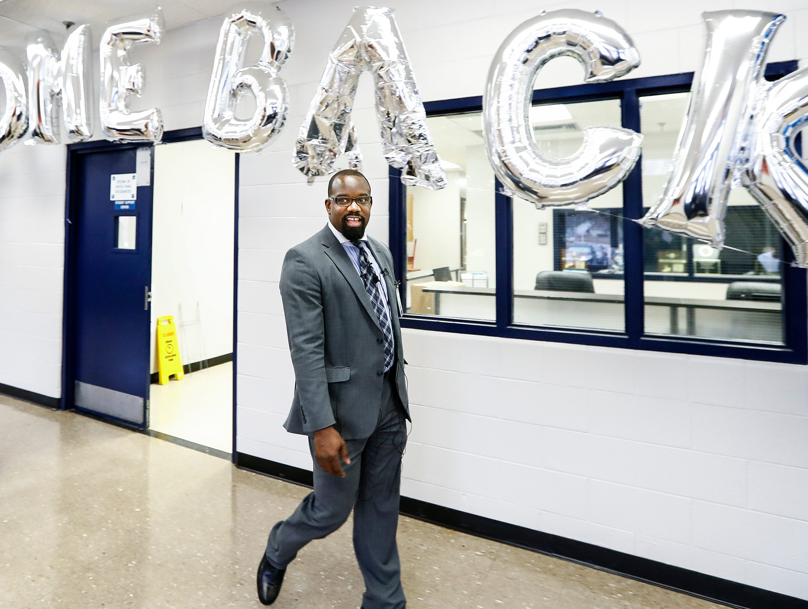 Kirby High School Principal Sheevon Hunter leads a media tour of the updated school that will be reopening on Monday following months of rat abatement.