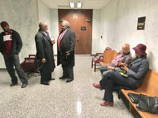 Members of a Memphis based black farmers group inside a courtroom.