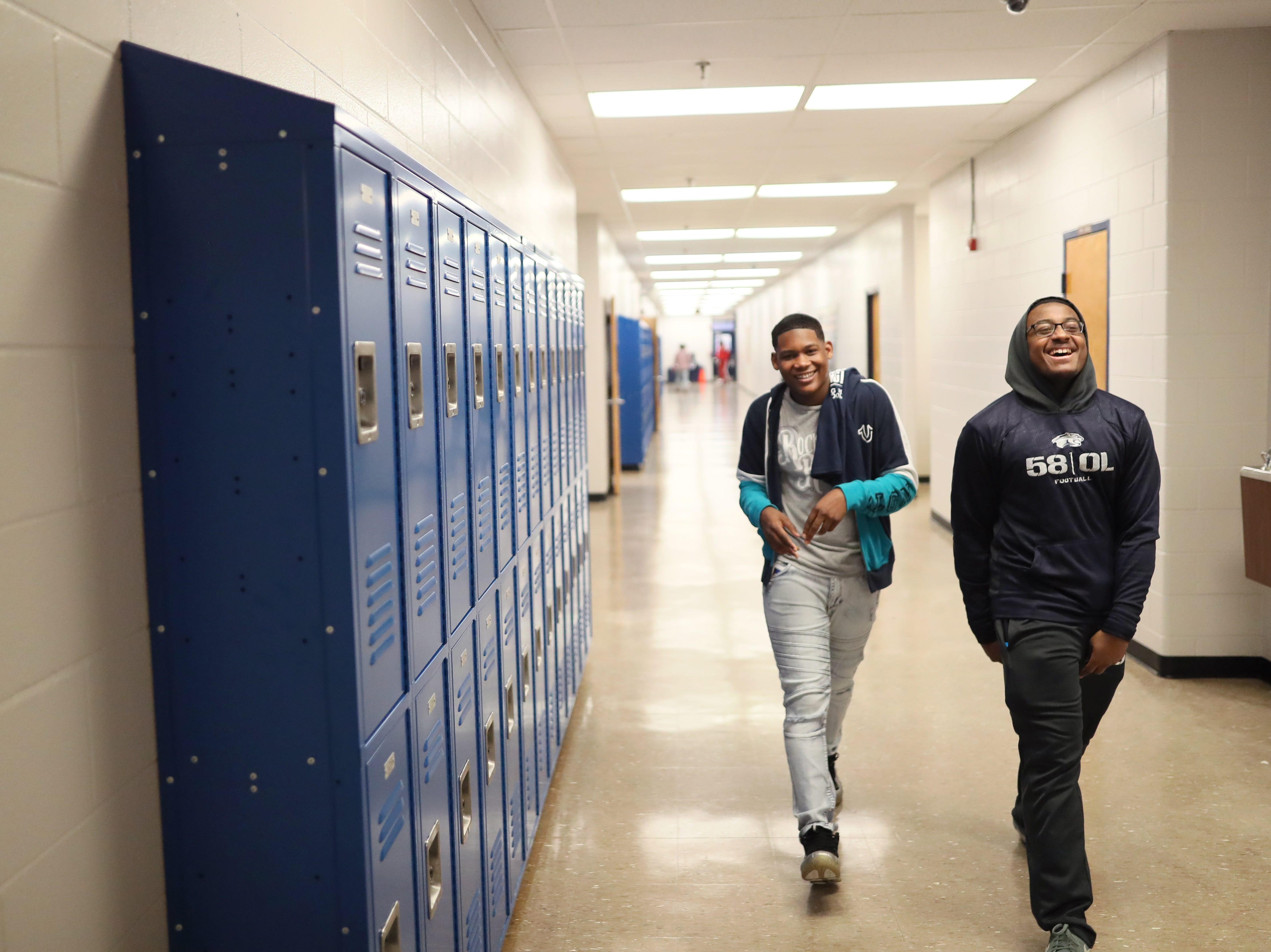 Kirby High School students Bryson Blocker, left, sophomore, and Zachary Hill, senior, share a laugh as they tour the facility with faculty and community members Friday. The school is planning to officially reopen Monday, January 7, 2019 after months of being closed due to a rodent infestation.