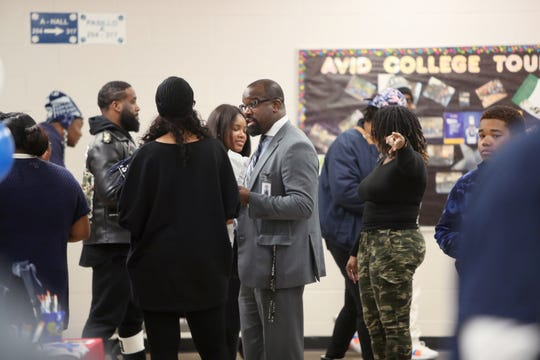 A file photo shows Kirby High School principal Steevon R. Hunter with faculty and community members at the school's January 2019 reopening. Hunter sent a note to parents on Sept. 30, 2019 after a fight broke out at the school in which police used pepper spray.