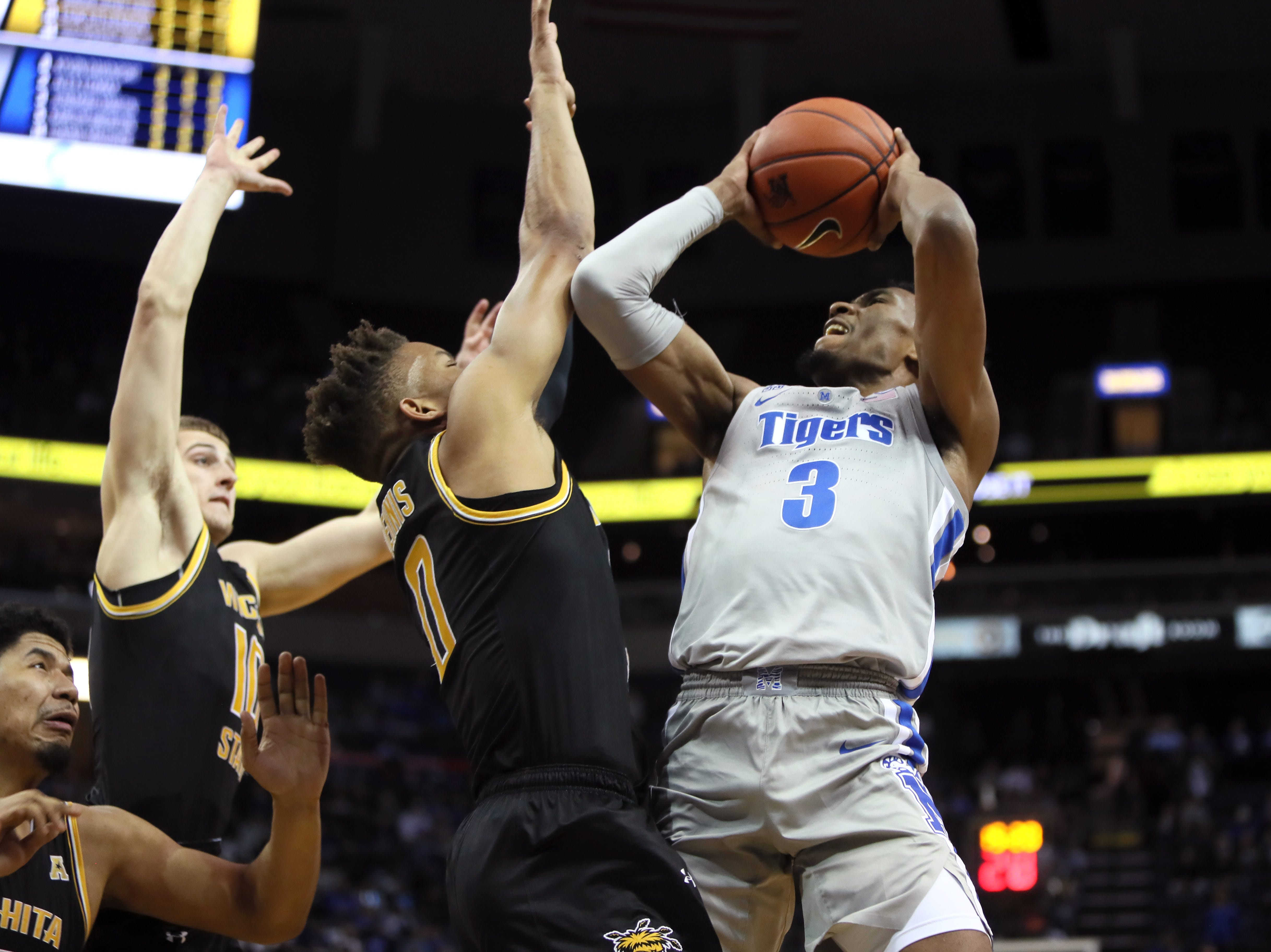 Memphis Tigers guard Jeremiah Martin shoots the ball over Wichita State Shockers guard Dexter Dennis during their game at the FedExForum on Thursday, Jan. 3, 2019.