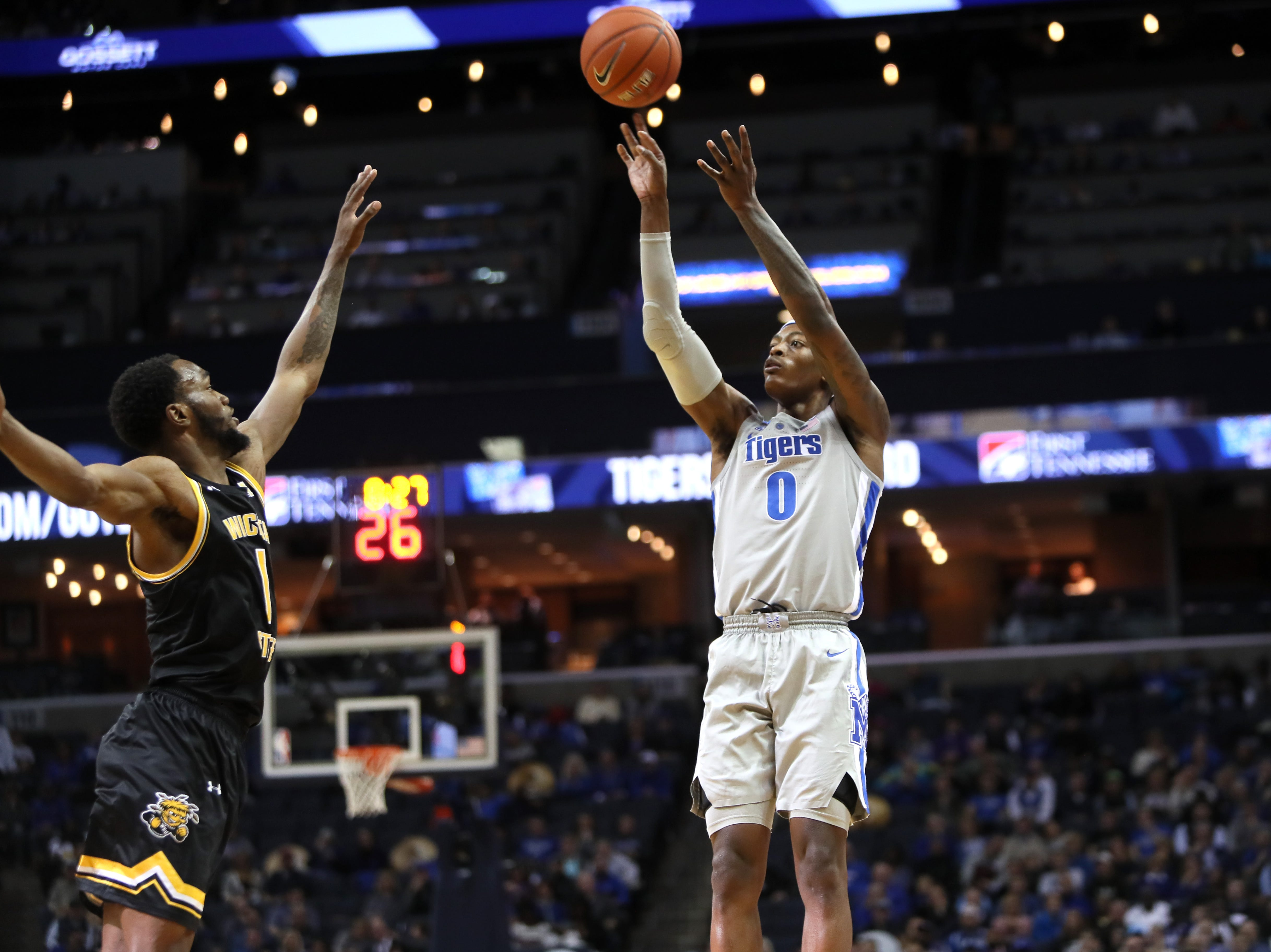 Memphis Tigers forward Kyvon Davenport makes a 3-pointer over shoots the ball over Wichita State Shockers forward Markis McDuffie during their game at the FedExForum on Thursday, Jan. 3, 2019.