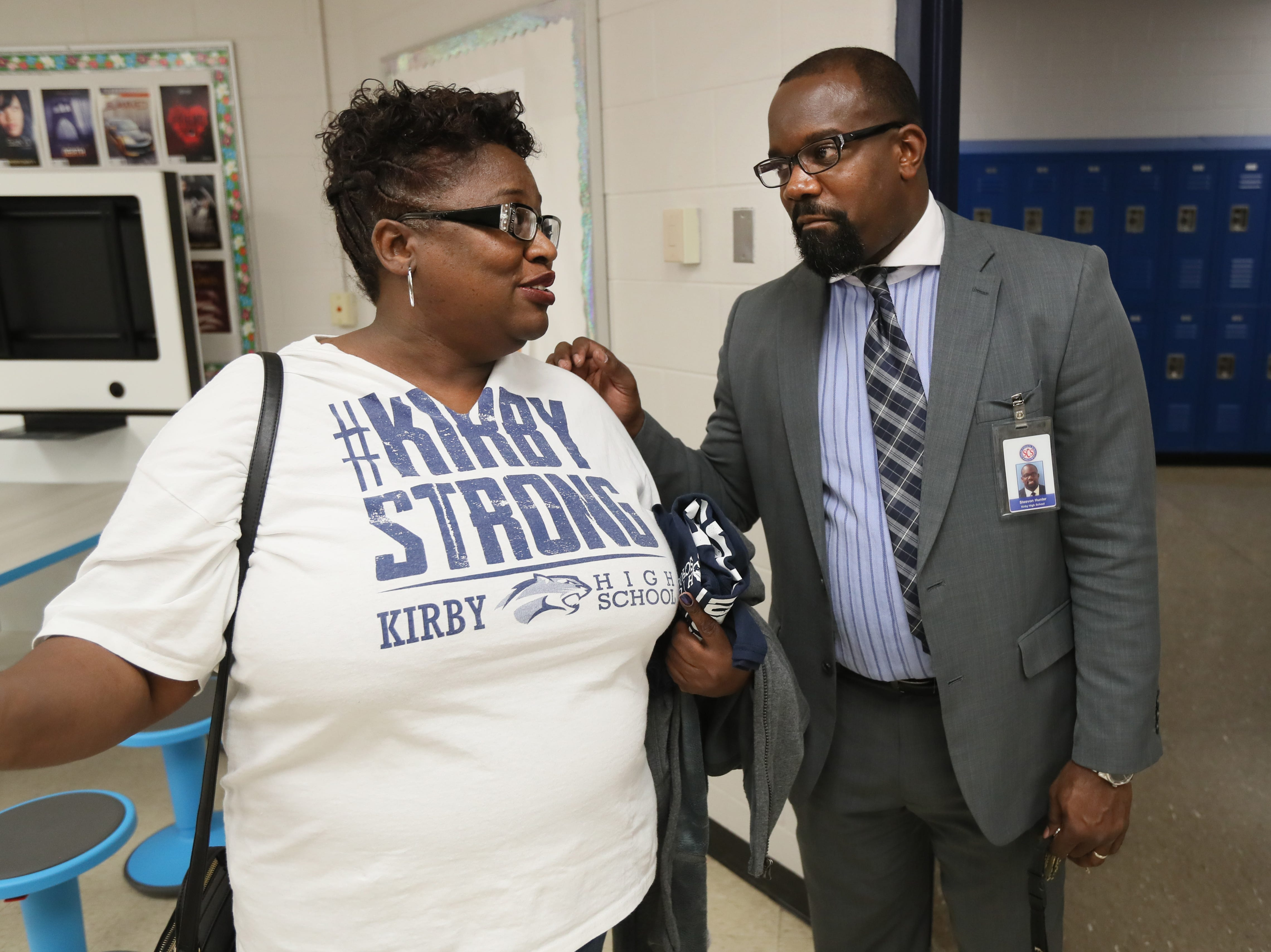 Kirby High School Principal Steevon Hunter chats with Helen Collins, whose daughter is a freshman at the school, as students, faculty and community members tour the upgrades to the building Friday. The school is planning to officially reopen Monday, January 7, 2019 after months of being closed due to a rodent infestation.