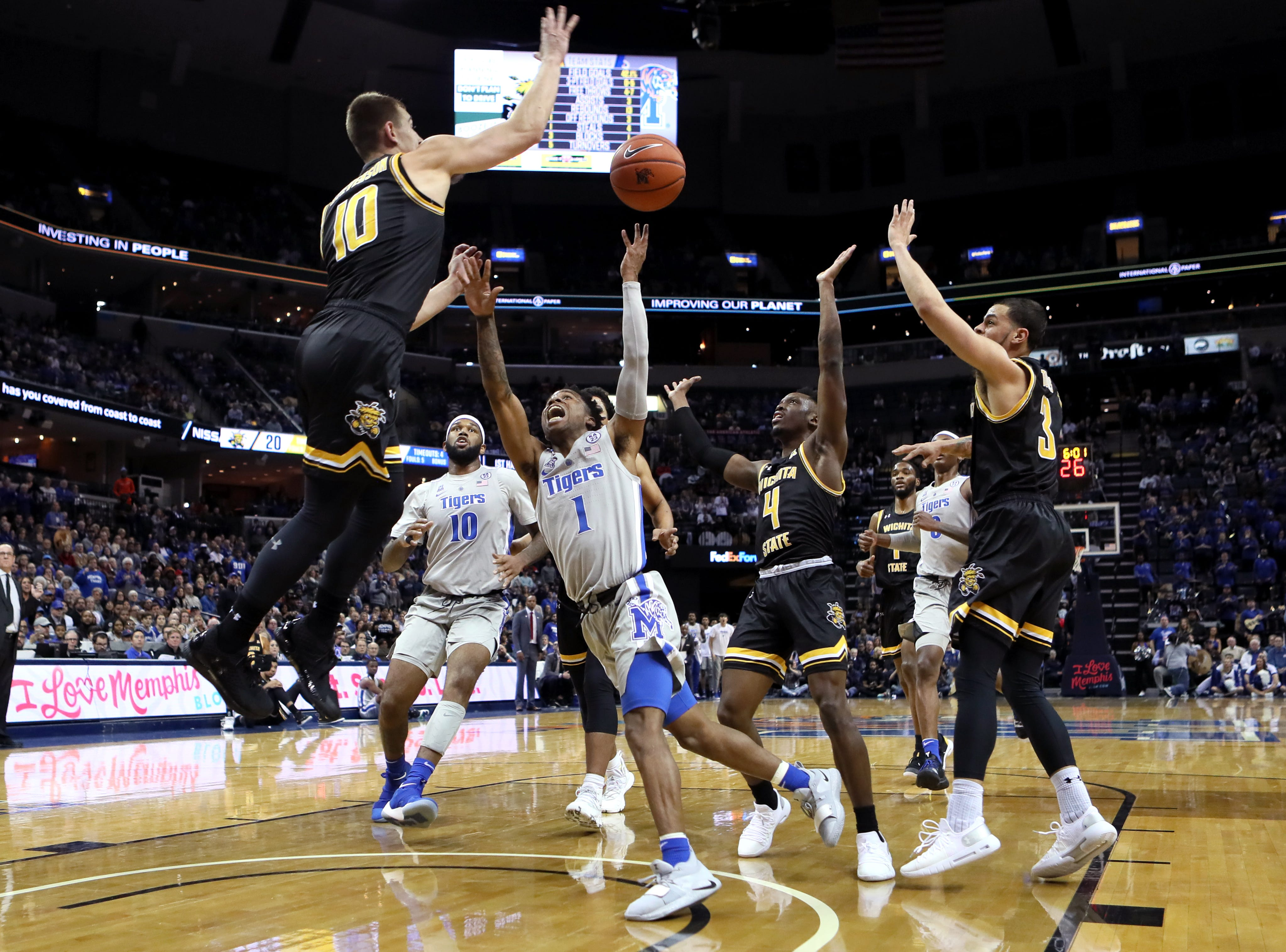 Memphis Tigers guard Tyler Harris is fouled on a drive to the hoop against the Wichita State Shockers during their game at the FedExForum on Thursday, Jan. 3, 2019.