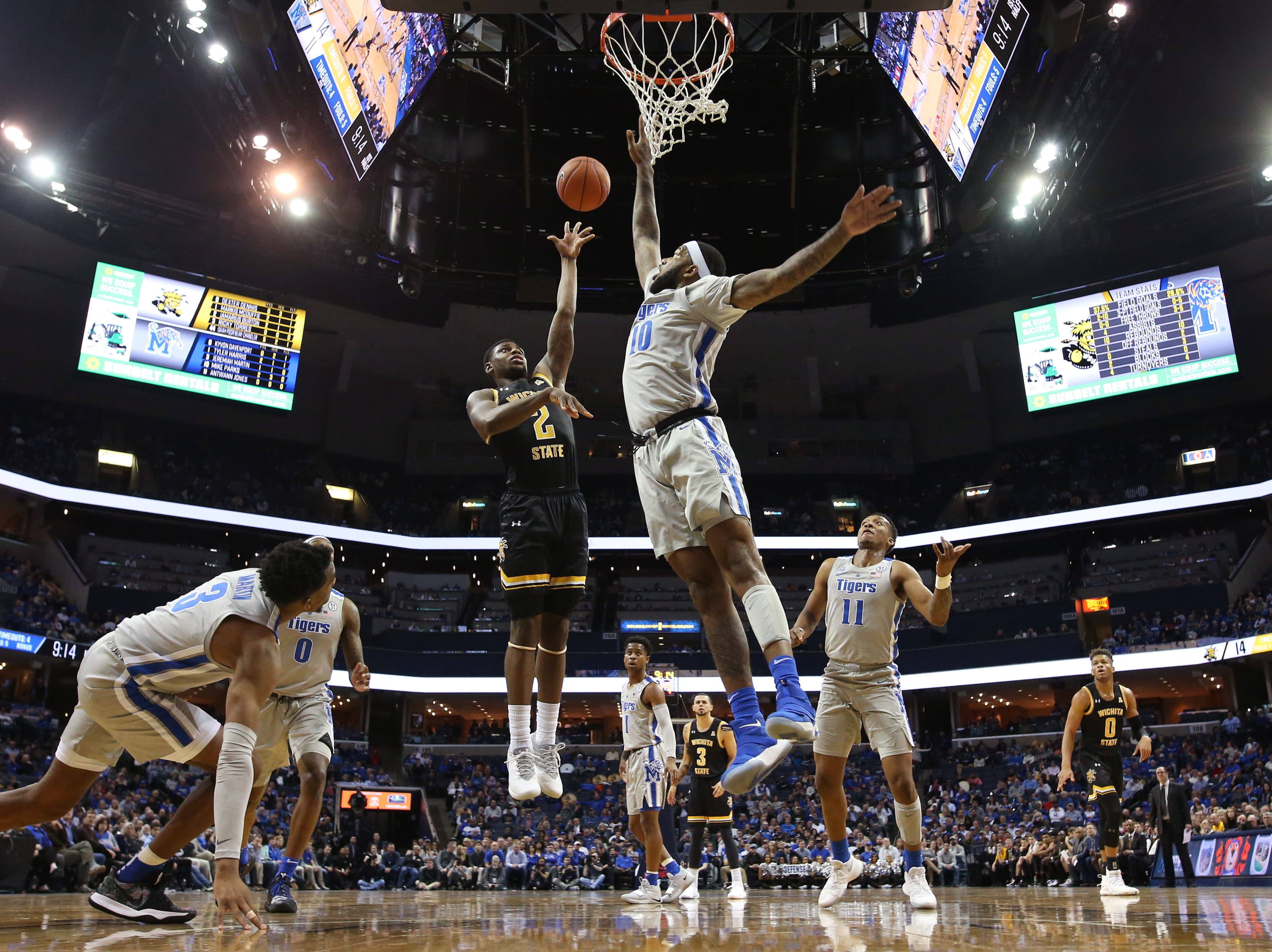 Memphis Tigers forward Mike Parks Jr. blocks a shot by Wichita State Shockers forward Jamarius Burton during their game at the FedExForum on Thursday, Jan. 3, 2019.