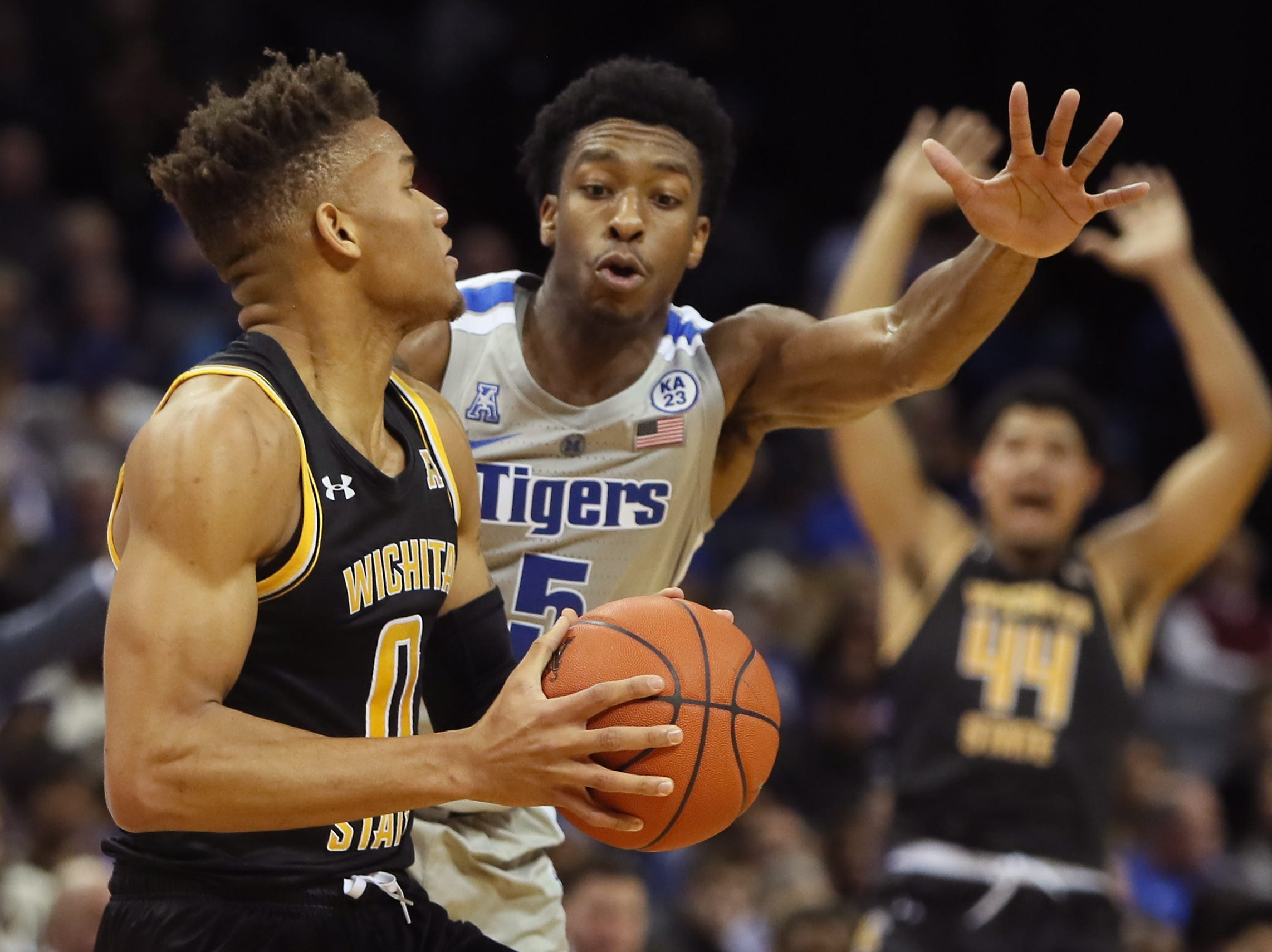 Memphis Tigers guard Kareem Brewton Jr. defends Wichita State Shockers guard Dexter Dennis during their game at the FedExForum on Thursday, Jan. 3, 2019.