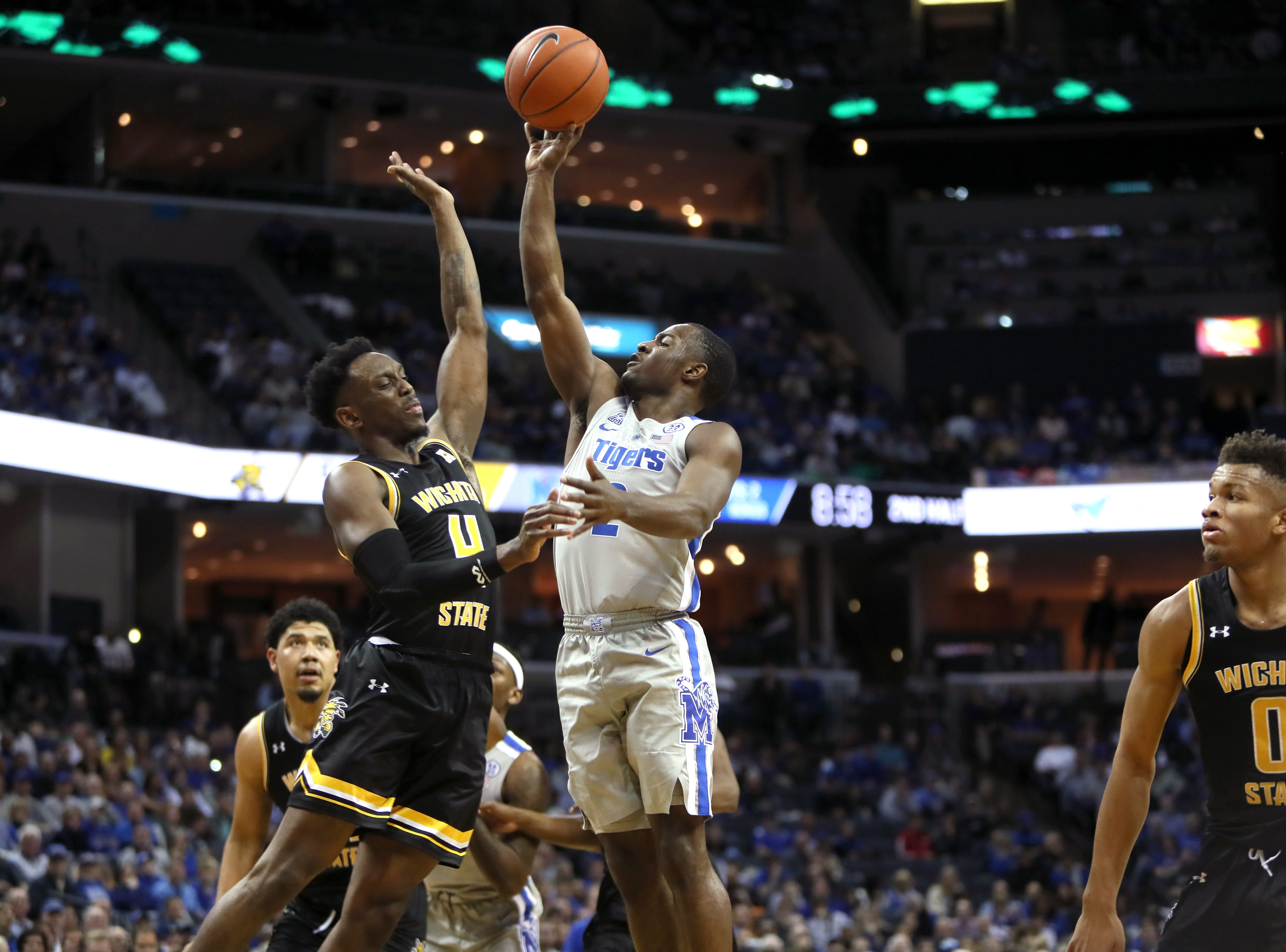 Memphis Tigers guard Alex Lomax shoots the ball over Wichita State Shockers guard Samajae Haynes-Jones during their game at the FedExForum on Thursday, Jan. 3, 2019.