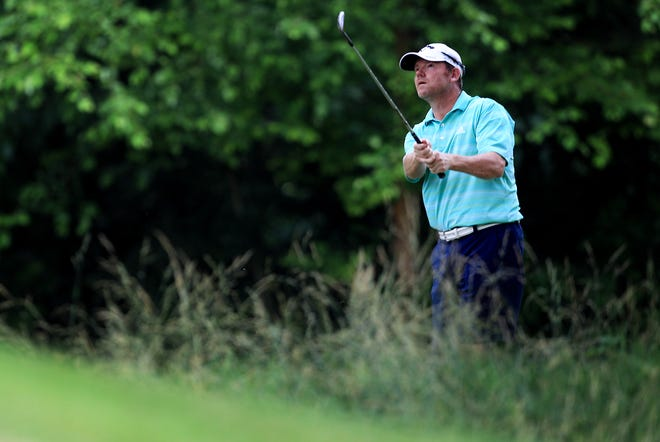 Shaun Micheel hits out of the rough during United States Golf Association 2015 U.S. Open sectional qualifying at Germantown Country Club