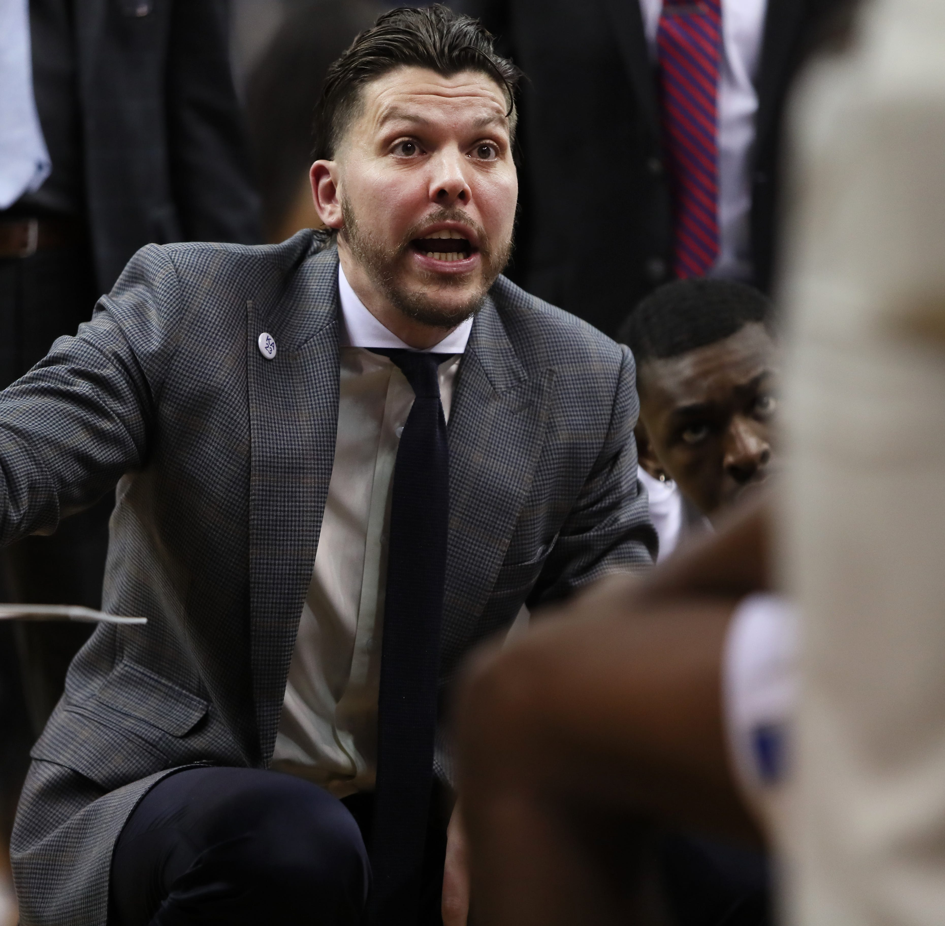 Who did Memphis basketball assistant Mike Miller watch at the Nike EYBL event Friday?