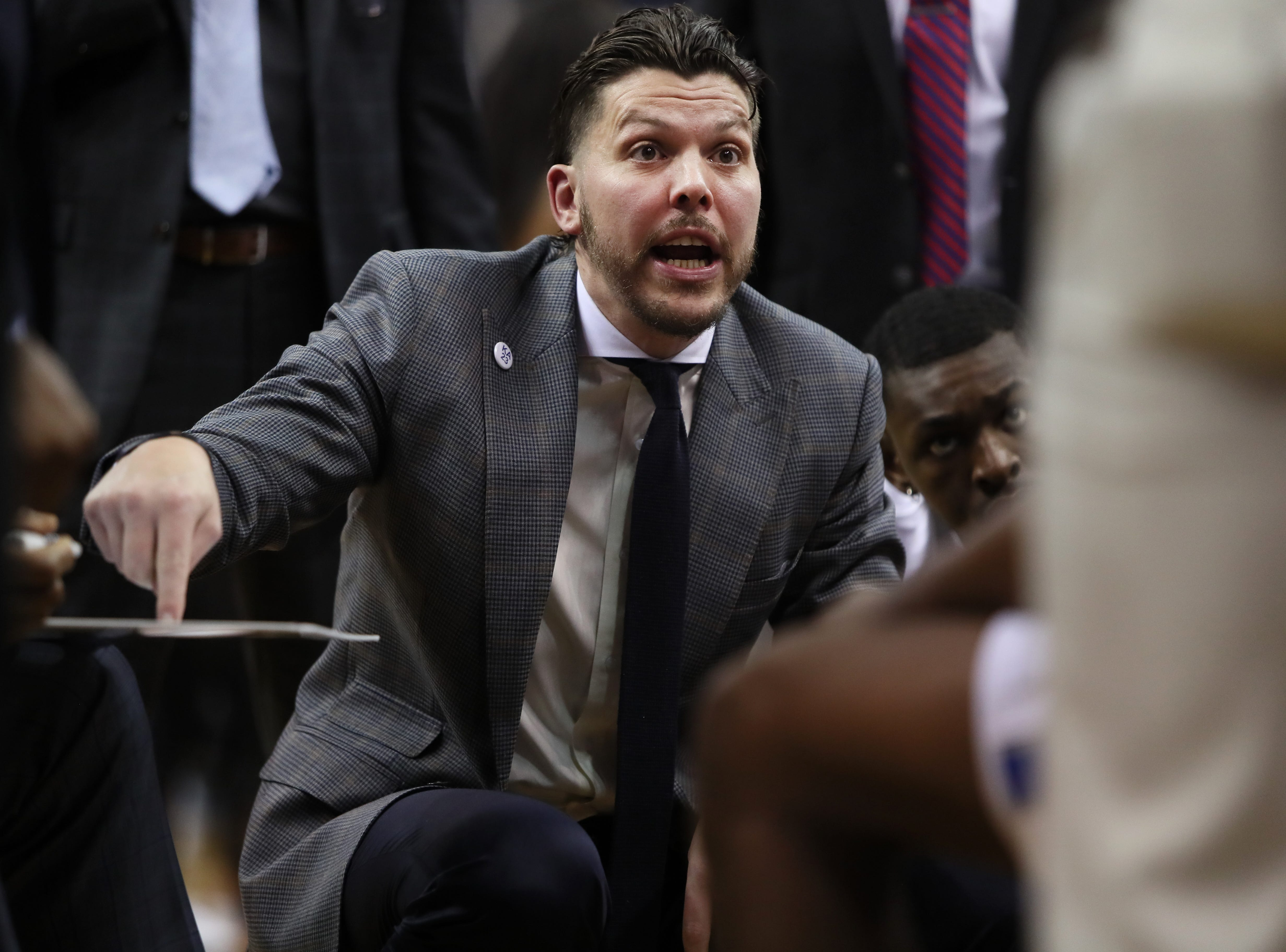 Memphis Tigers Assistant Coach Mike Miller talks to his team during a timeout in their game against the Wichita State Shockers at the FedExForum on Thursday, Jan. 3, 2019.