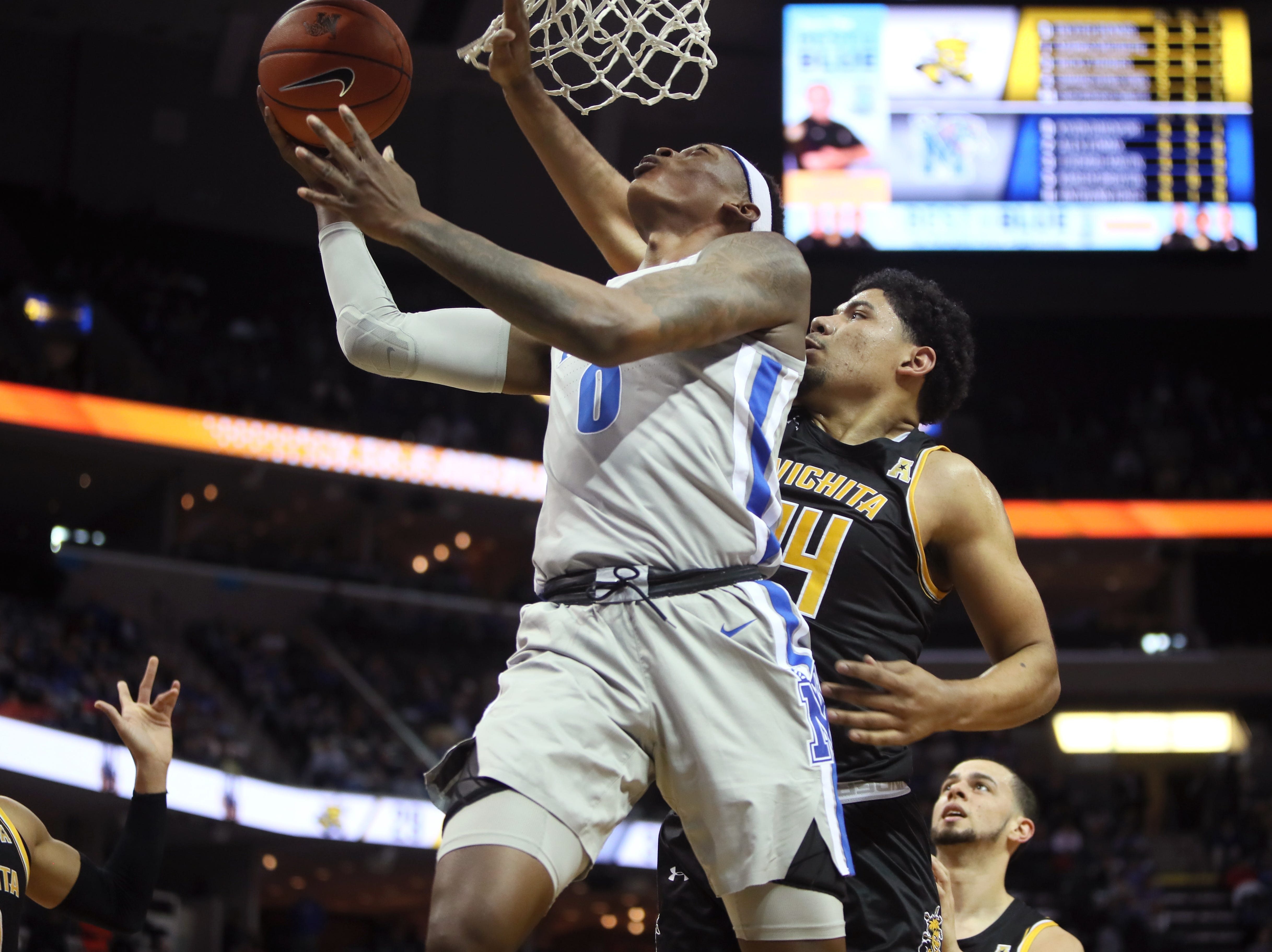 Memphis Tigers forward Kyvon Davenport shoots the ball over Wichita State Shockers forward Isaiah Poor Bear-Chandler during their game at the FedExForum on Thursday, Jan. 3, 2019.