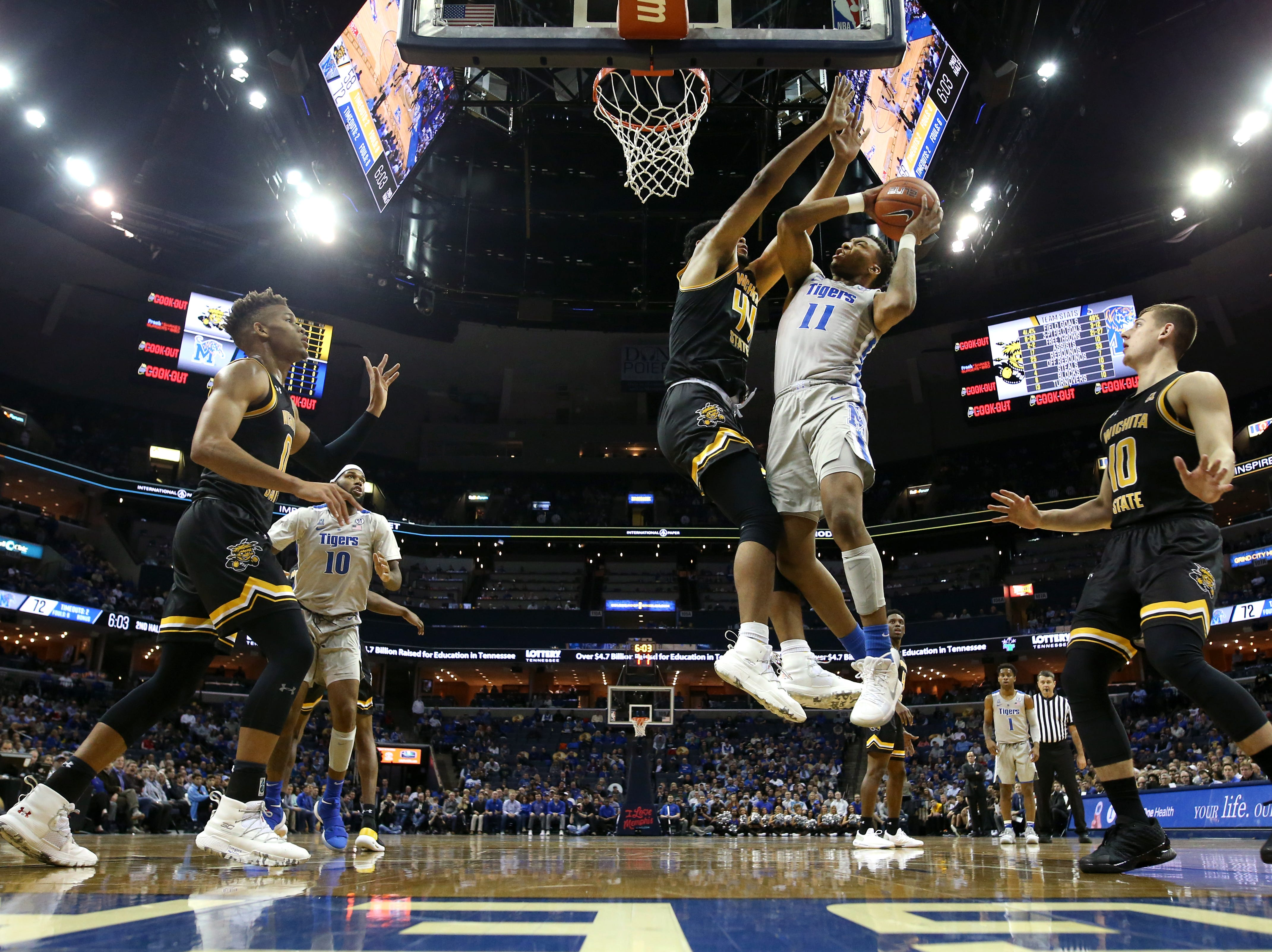 Memphis Tigers guard Antwann Jones shoots the ball over Wichita State Shockers forward Isaiah Poor Bear-Chandler during their game at the FedExForum on Thursday, Jan. 3, 2019.