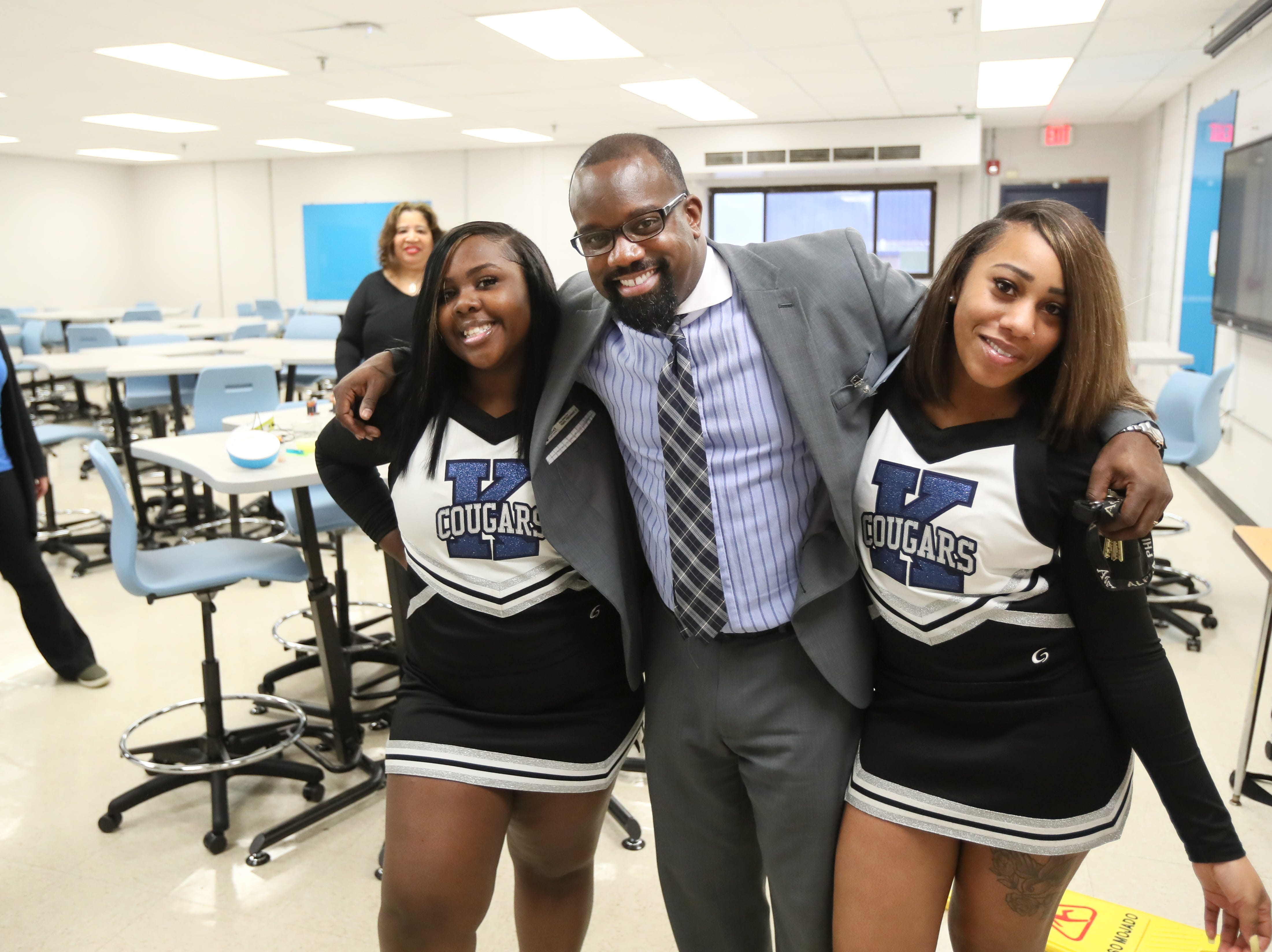 Kirby High School senior Alexius Smith, from left, Principal Steevon Hunter and senior Lakeisha Scott pose for a photo as the school opens its doors for a tour the building's upgrades Friday. The school is planning to officially reopen Monday, January 7, 2019 after months of being closed due to a rodent infestation.
