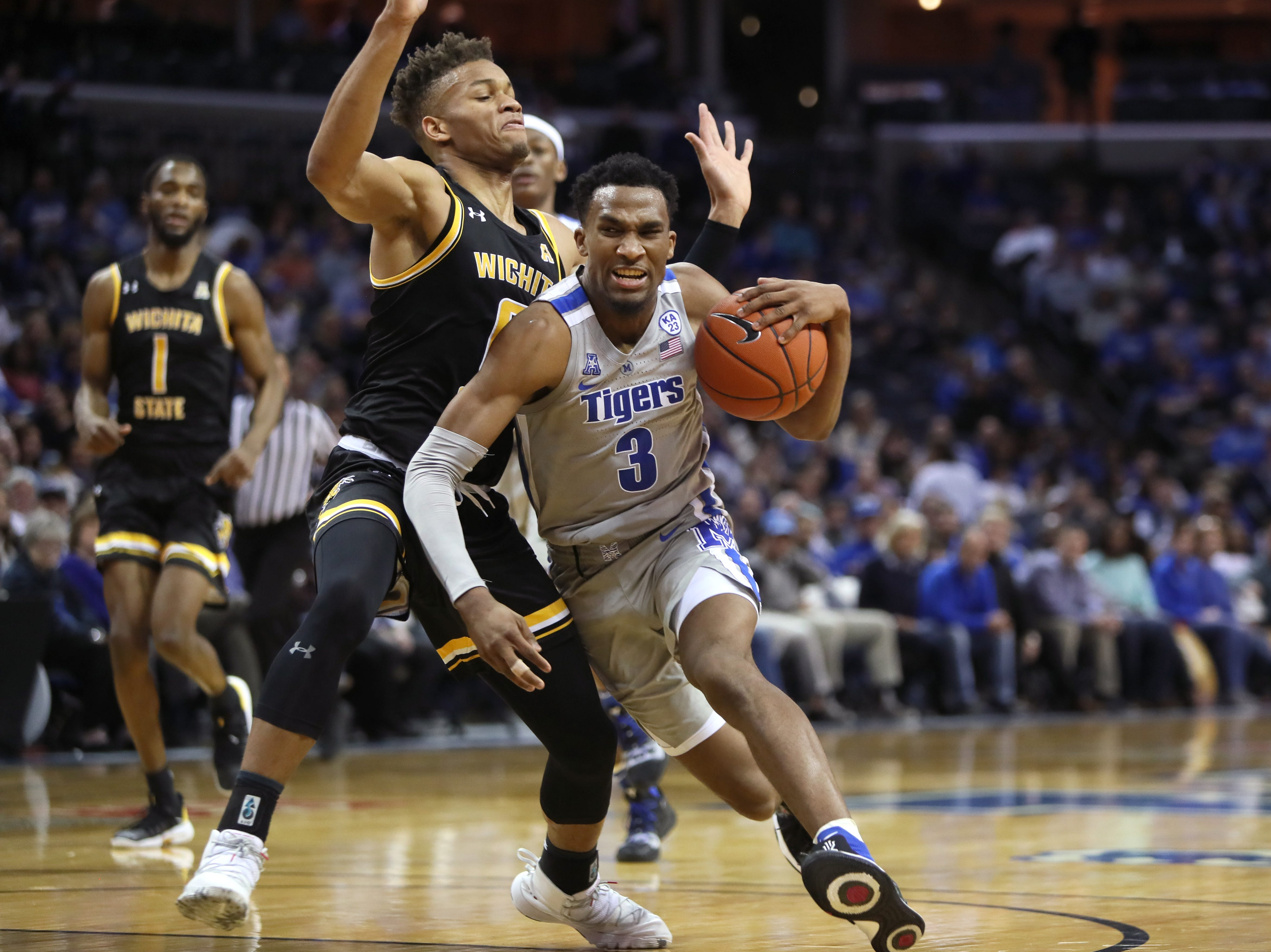 Memphis Tigers guard 	Jeremiah Martin drives past Wichita State Shockers guard Dexter Dennis during their game at the FedExForum on Thursday, Jan. 3, 2019.