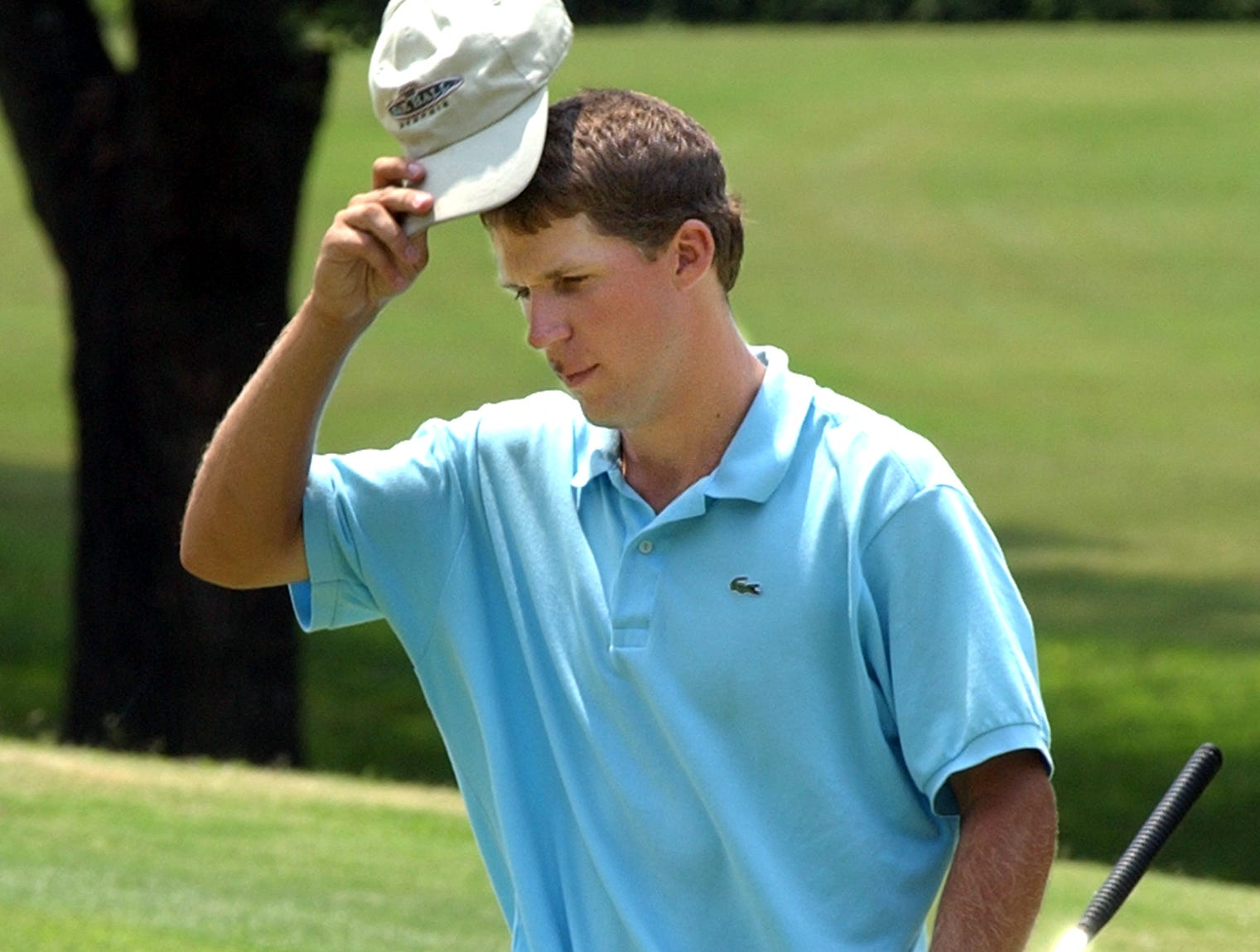 Thu, 22 Jul 04 (ddmga3)  DIGITAL IMAGE by Dave Darnell.  Alan Weant (cq) tips his cap after winning the MGA Amateur Championship at Germantown Country Club.  He finished at 218 to win the 54-hole event.  Brice Bailey (cq) (Not Pictured) finished second at 219 and Matt Lingle (cq) (Not Pictured) finished third at 220.
