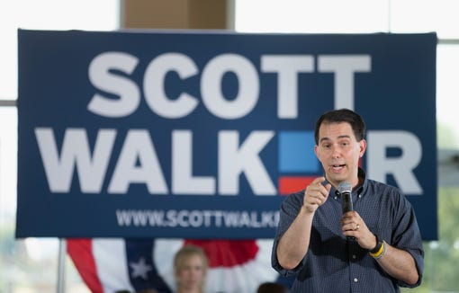 Scott Walker speaks to guests gathered for a campaign event at Modern Woodman Park on July 17, 2015, in Davenport, Iowa.