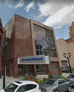 Bank Mutual's former downtown Milwaukee office has been sold to a firm that will redevelop the property.