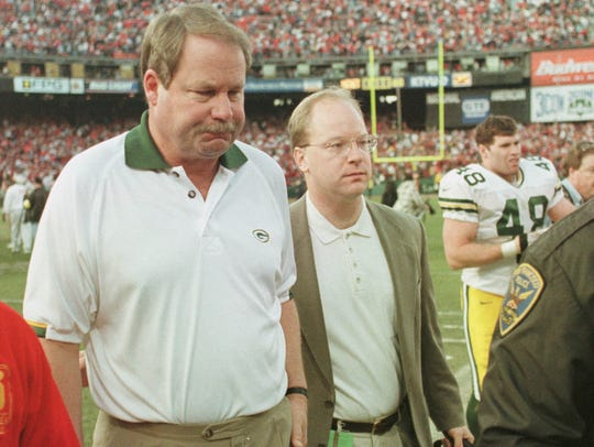 Mike Holmgren leaves the field after the Green Bay Packers' 30-27 loss to the San Francisco 49ers in a wild card playoff game Jan. 3, 1999 at 3Comm Park in San Francisco. It was Holmgren's last game as coach of the Packers.