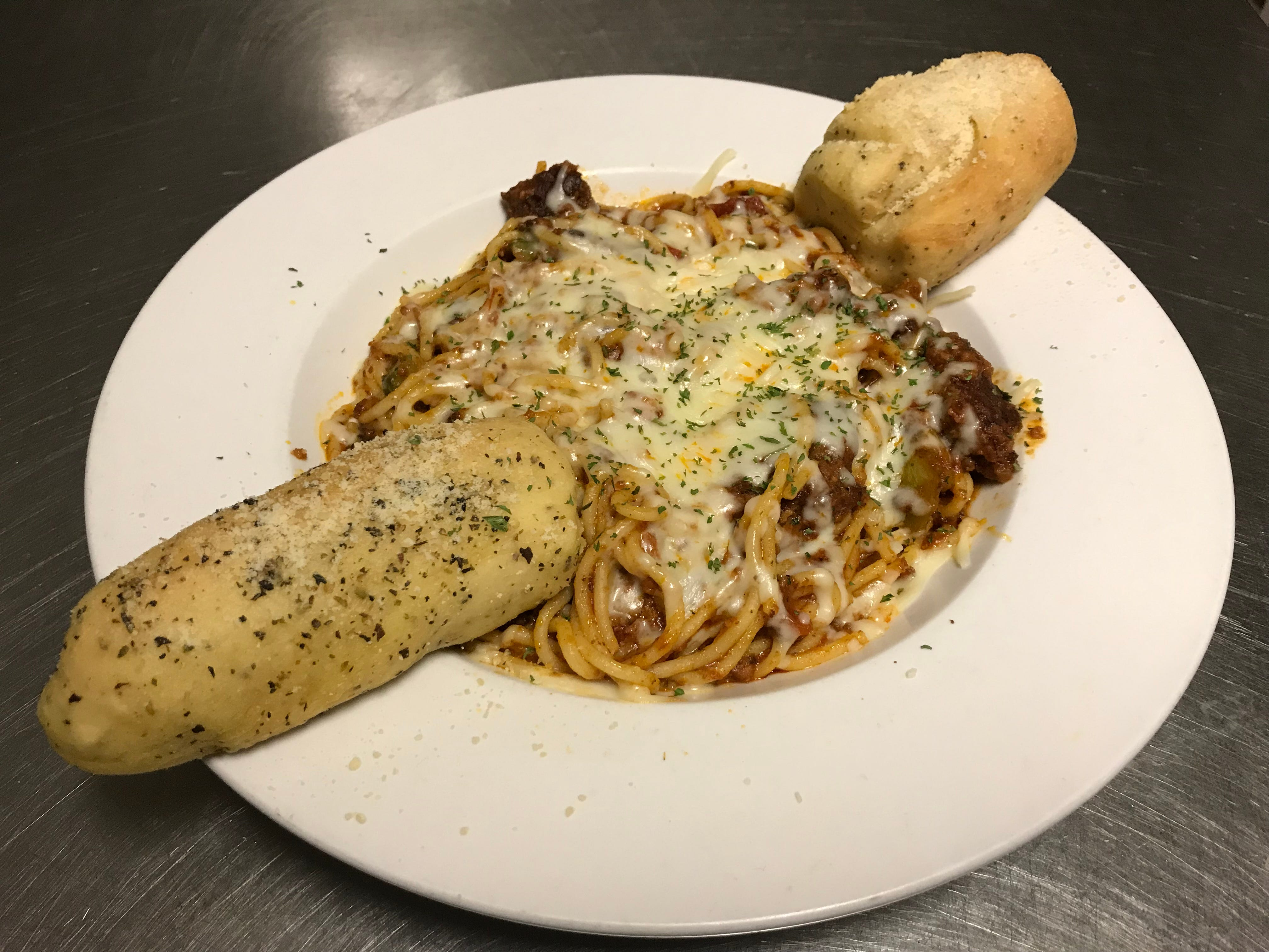 The Italian Spaghetti is served with Amalia's homemade meat sauce and garlic bread.