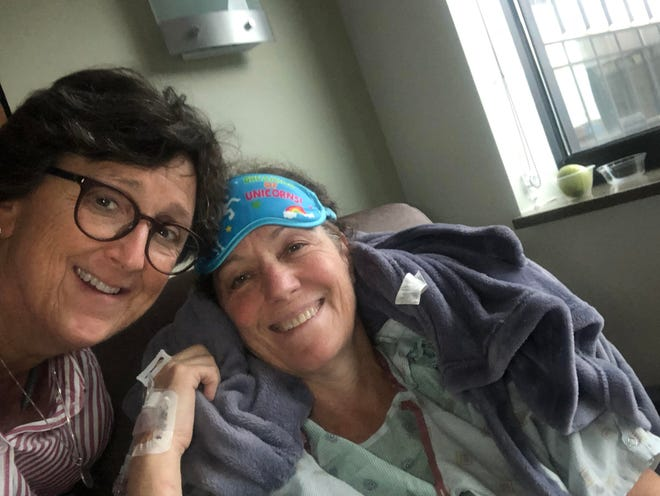 Meg Kissinger traveled to New Orleans to comfort her sister Patty Kissinger after her surgery for colon cancer. Both women ran up against large out-of-pocket charges for colonoscopies - Patty because she had symptoms, and Meg because colon cancer is now part of her family history.
