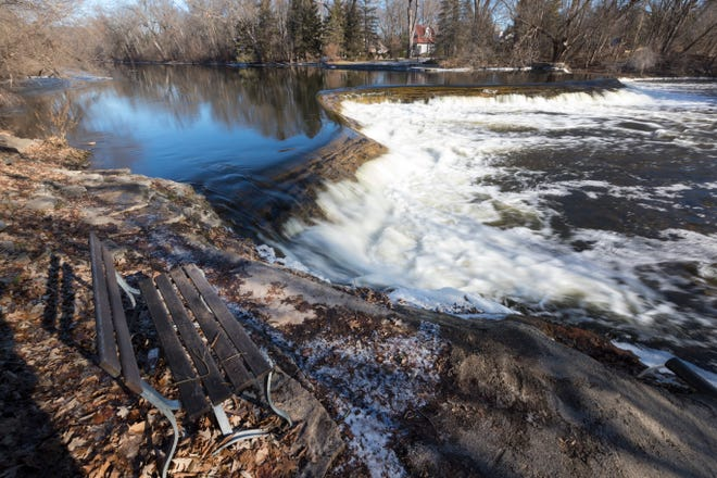 The Milwaukee River flows over the  Kletzsch Park dam in Glendale. The DNR and Milwaukee County are spending more than $1 million to rebuild the dam, an upgrade that will include for the first time a fish passage.  MARK HOFFMAN/MILWAUKEE JOURNAL SENTINEL