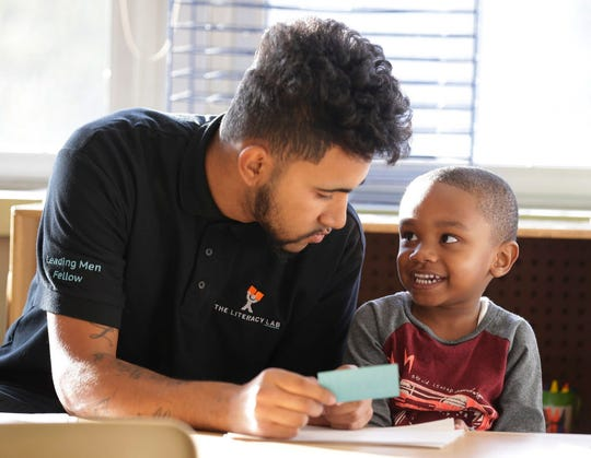 Patrick Jagiello instructs Tarrell Harvey on how to write the letters of his name. Jagiello works at Next Door Foundation as part of the Leading Men Fellows, a program created by the Washington, D.C.-based Literacy Lab to boost literacy skills in early childhood and expose young men of color to jobs in early childhood education.