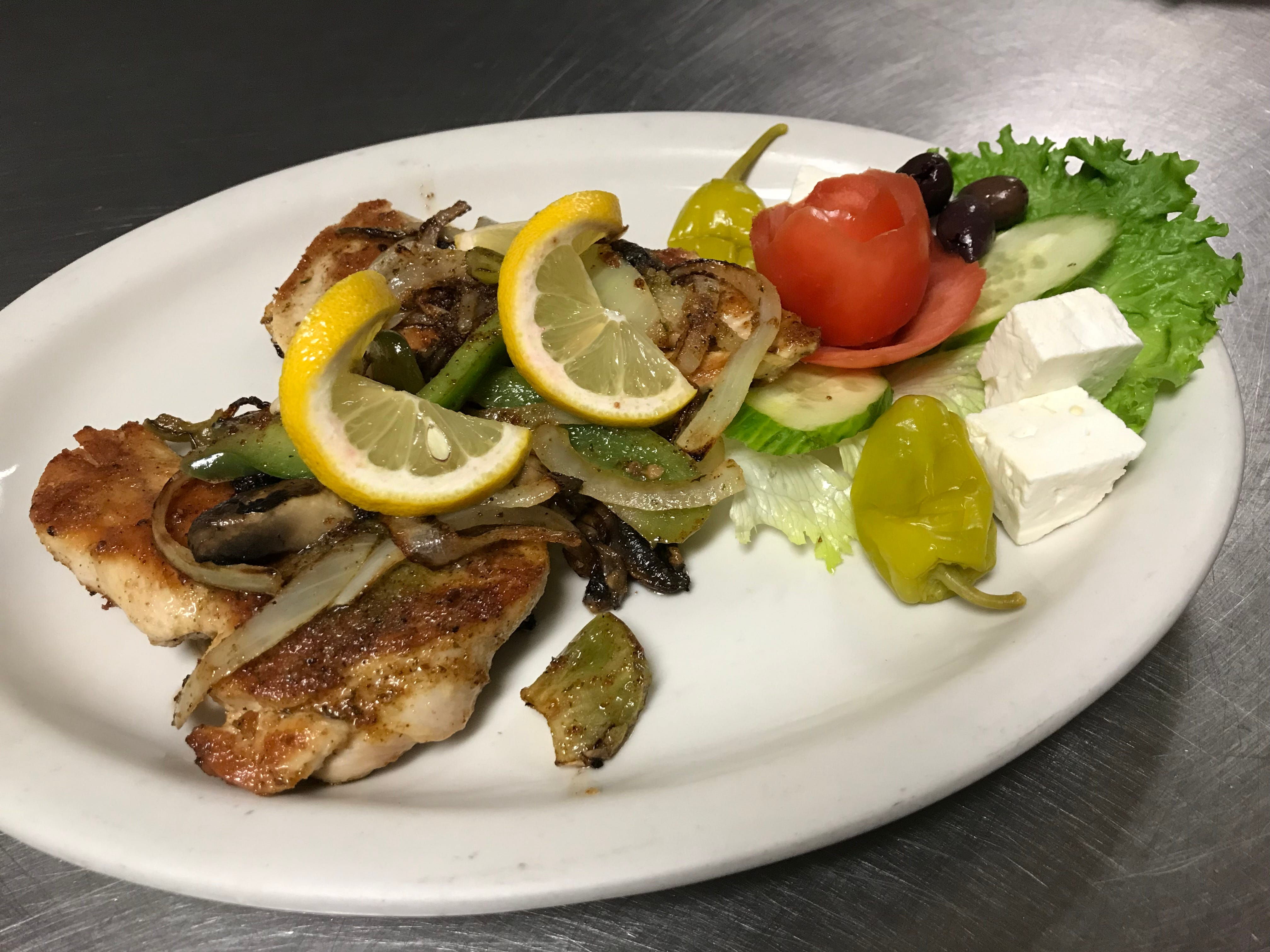The Athenian Chicken Breast is marinated in a blend of fresh Greek spices and topped with Amalia's special Athenian sauce.