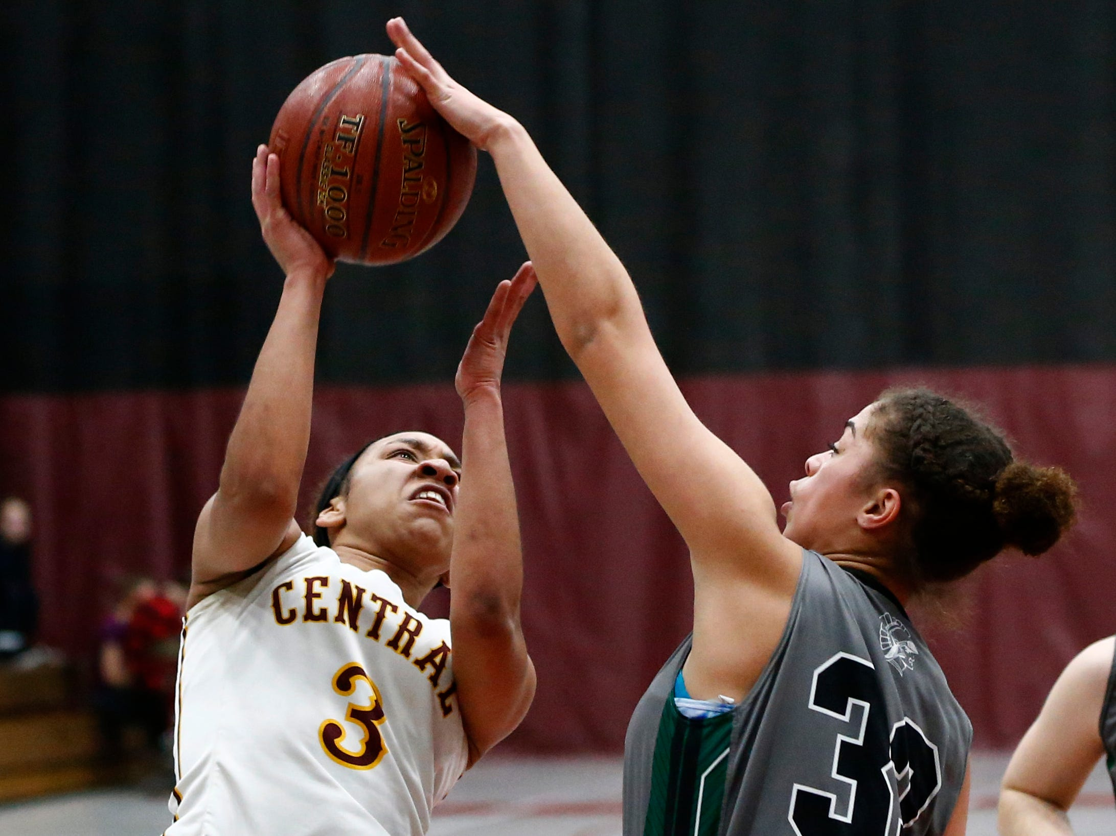 West Allis Central's Jaylah Baker is blocked from the basket by Wauwatosa West's Janessa Runyan at Central on Jan. 3.