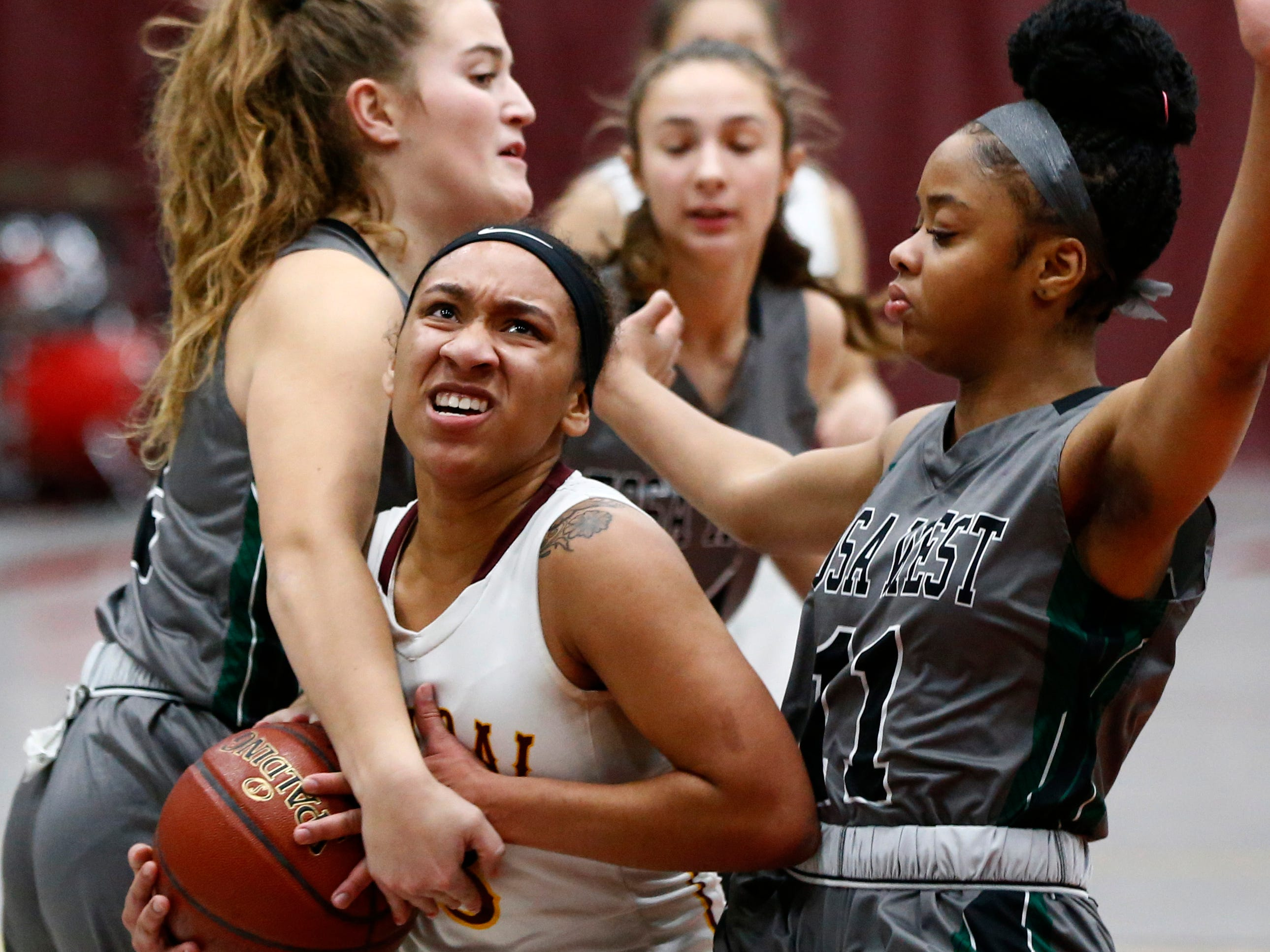 West Allis Central's Jaylah Baker is trapped by Wauwatosa West's Madison Liebenthal (left) and Maliya Harris at Central on Jan. 3.