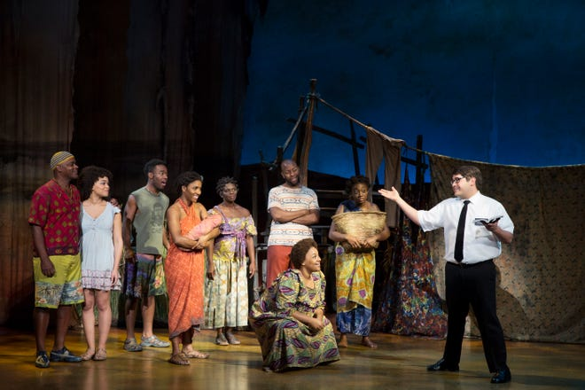 "Conner Peirson (right) preaches to Ugandan villagers in the musical ""The Book of Mormon."""