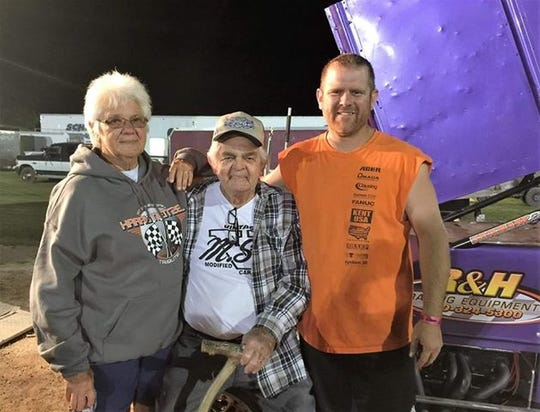 Wisconsin racing legend Fuzzy Fassbender is pictured with his wife, Judy, and son Lance after a sprint-car victory by Lance at the Plymouth (Wisconsin) Dirt Track.