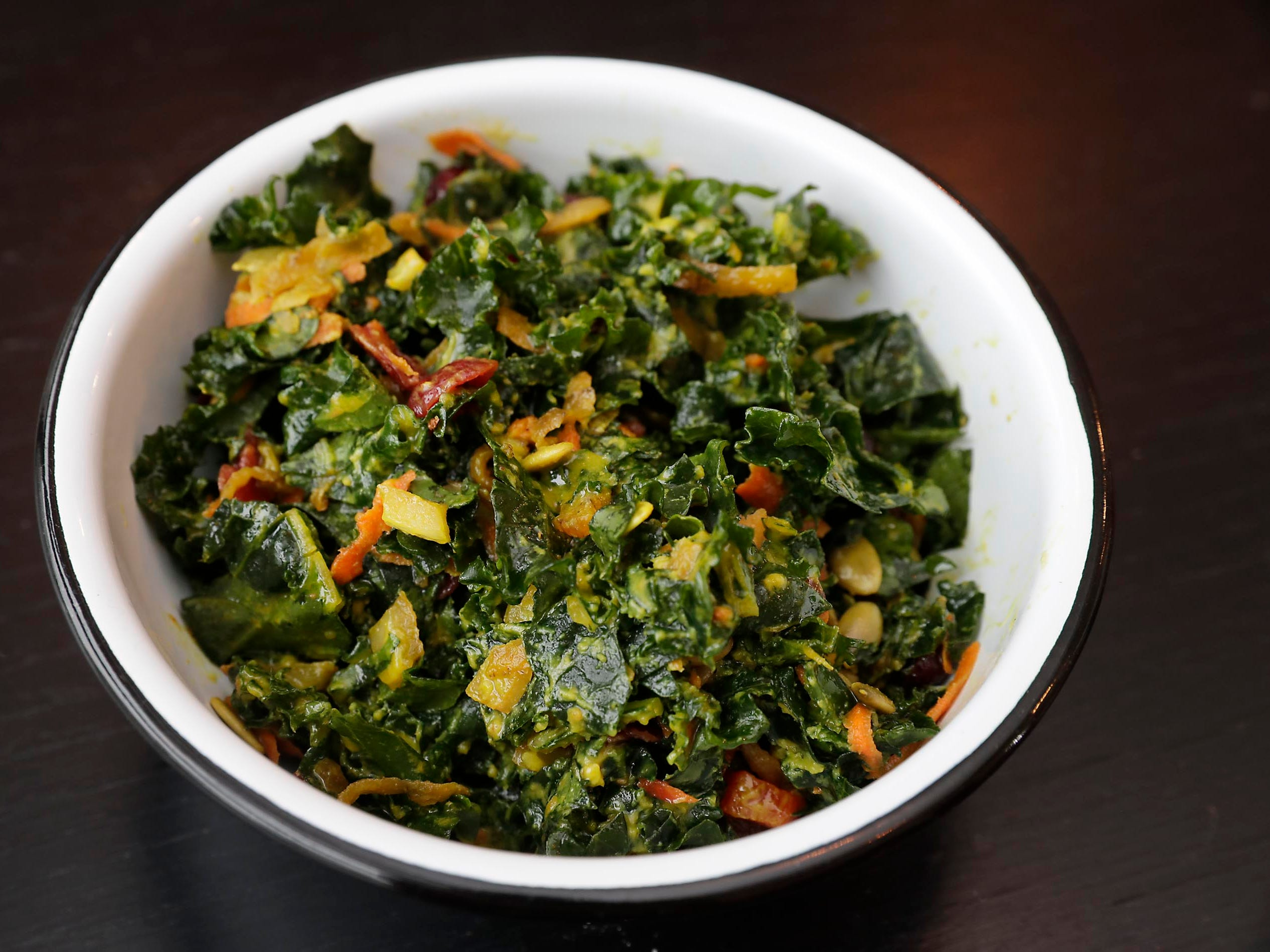 A kale salad is featured at  SmallPie. Salads and other side items work well with the many pies